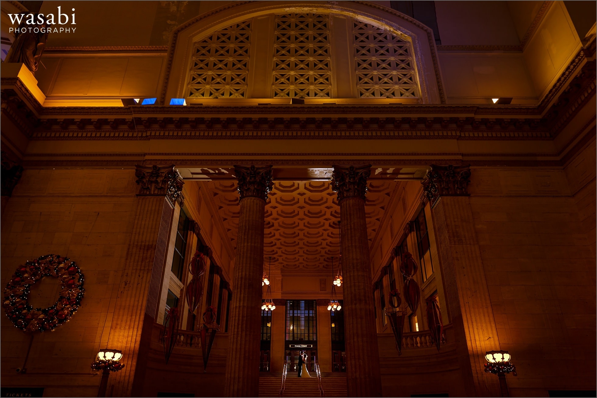 extreme wide angle indoor backlit portrait of bride and groom at Union Station in Chicago