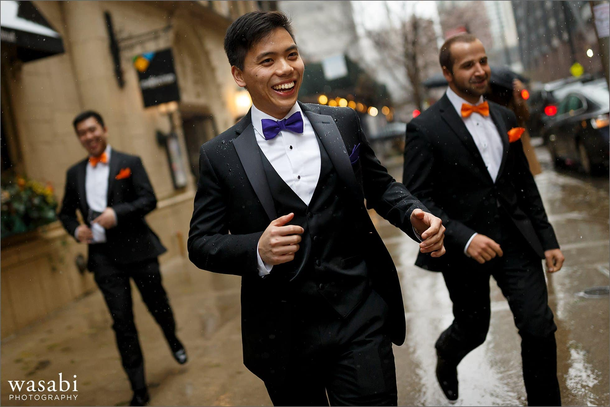 groom and groomsemen run through rain on wedding day