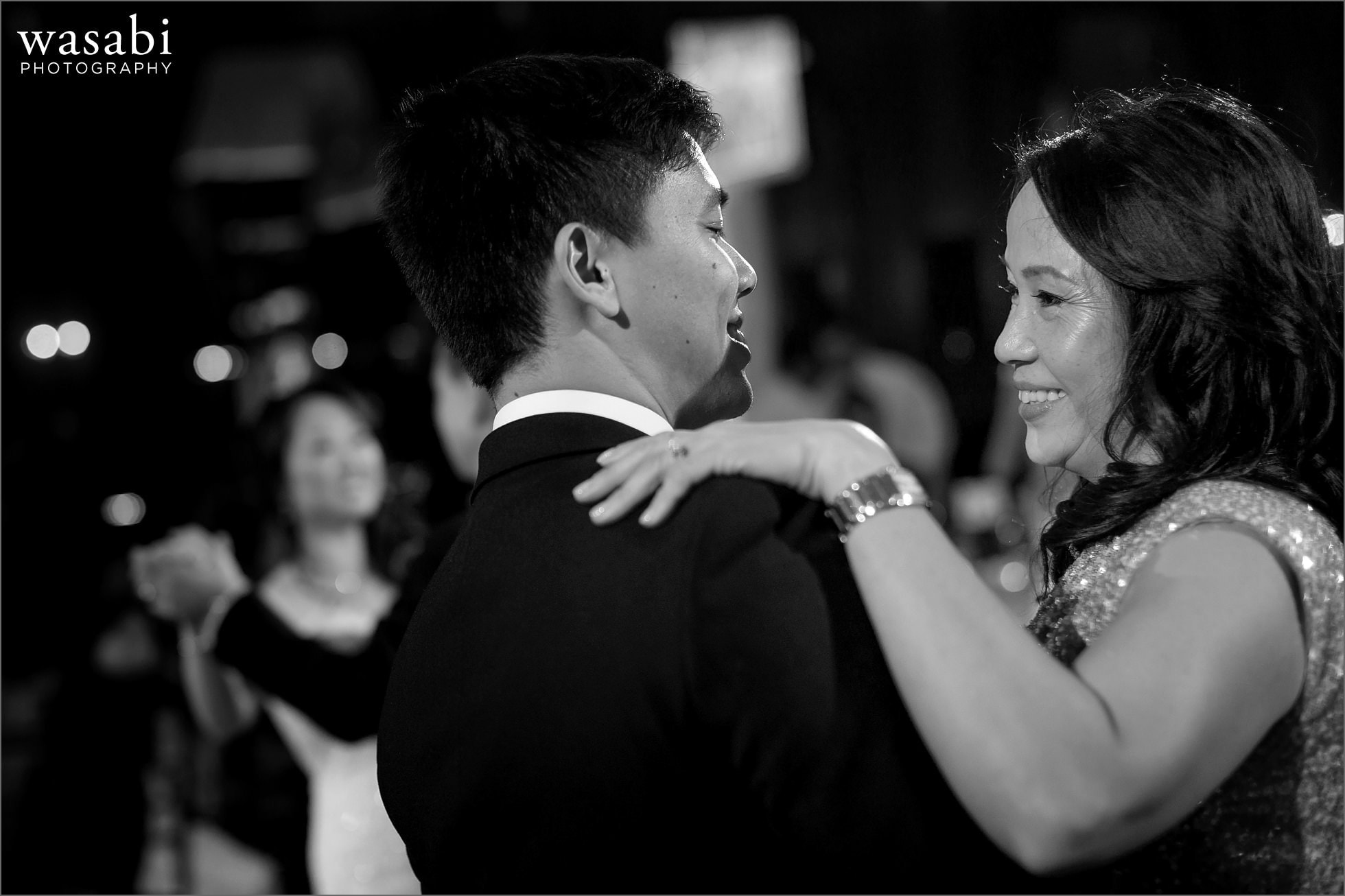 groom dances with mom during parent dance at Mongomery Club wedding reception