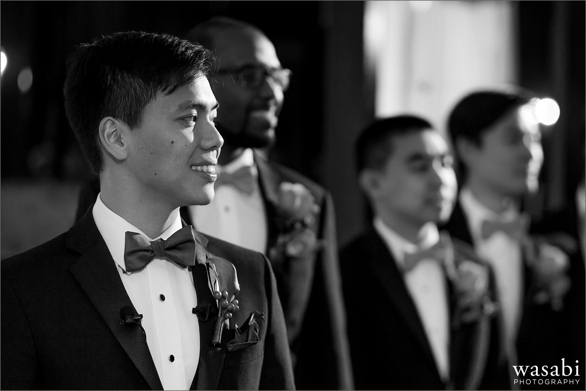 groom watches while bride walks down the aisle during wedding at Montgomery Club