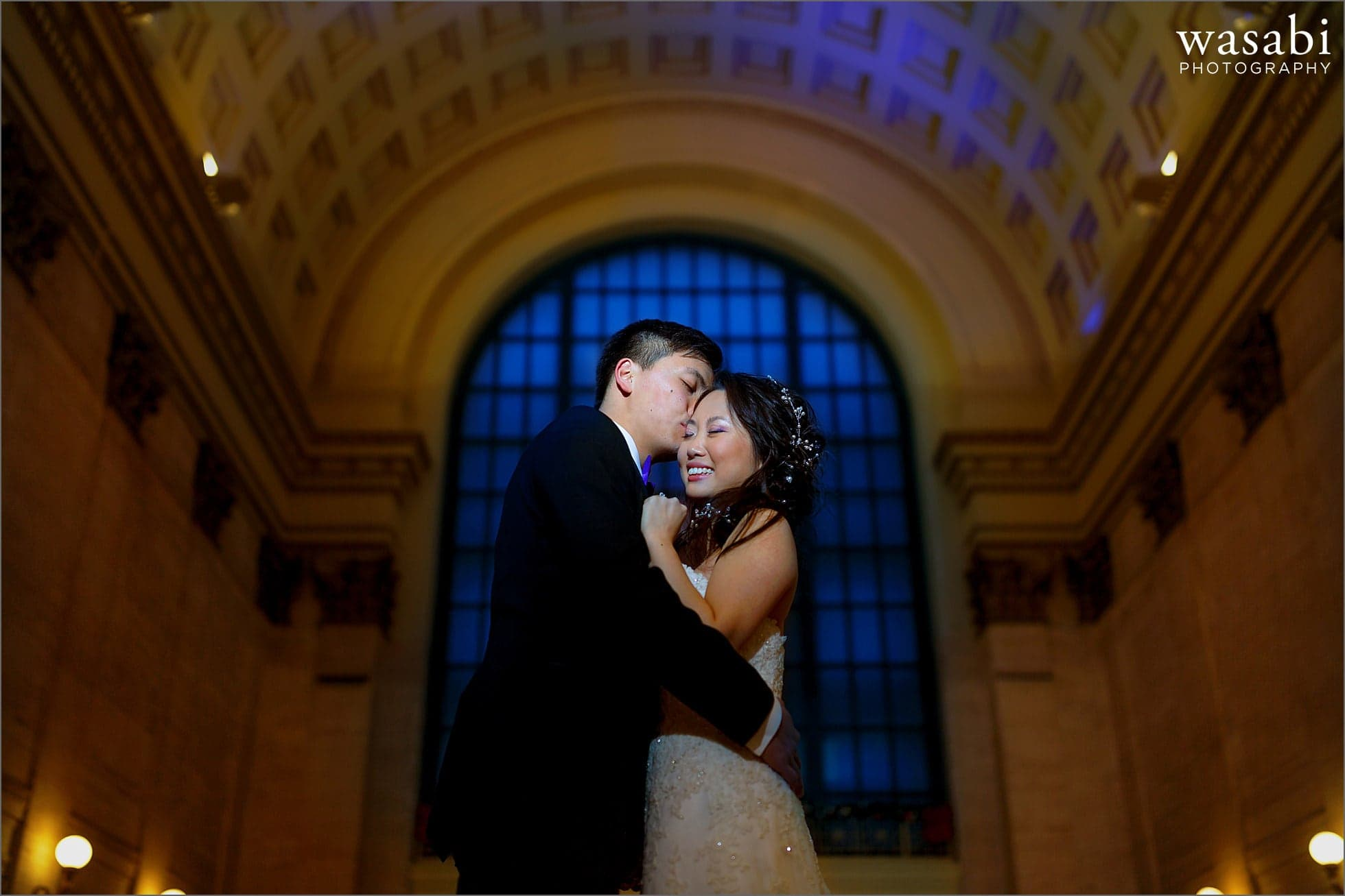 indoor lit portrait of bride and groom at Union Station in Chicago