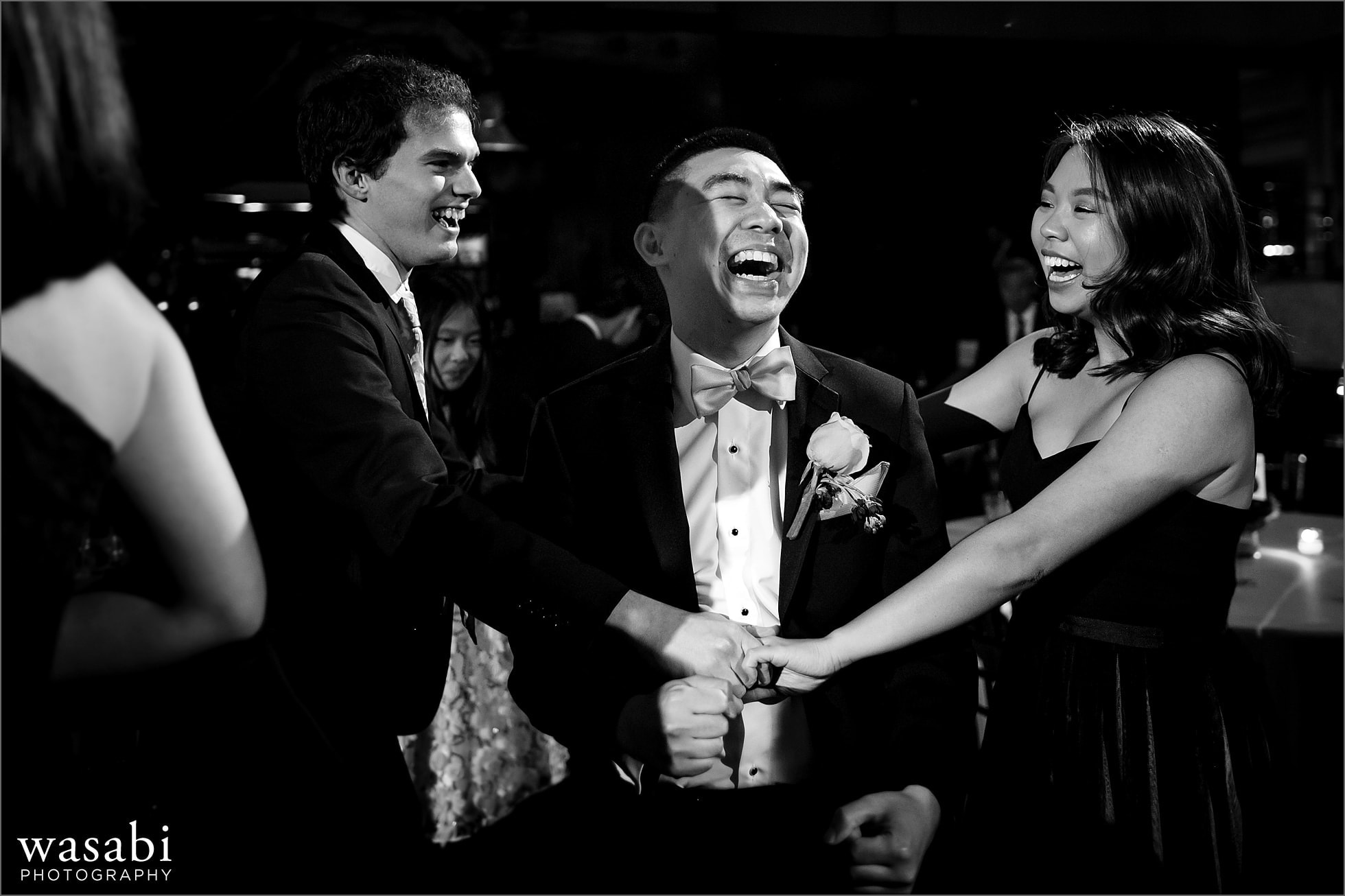 wedding guests dance during Montgomery Club wedding reception in Chicago