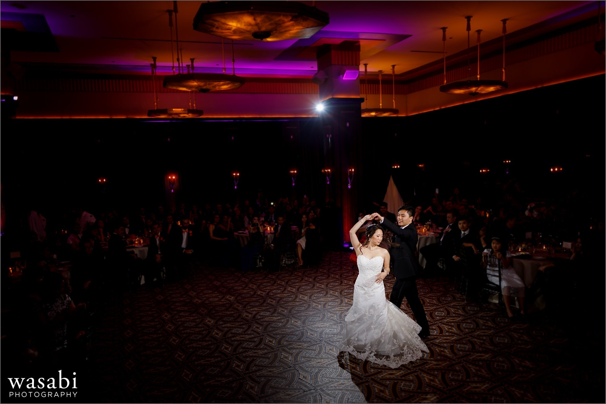 wide angle  of bride and groom choreographed first dance during Montgomery Club wedding reception