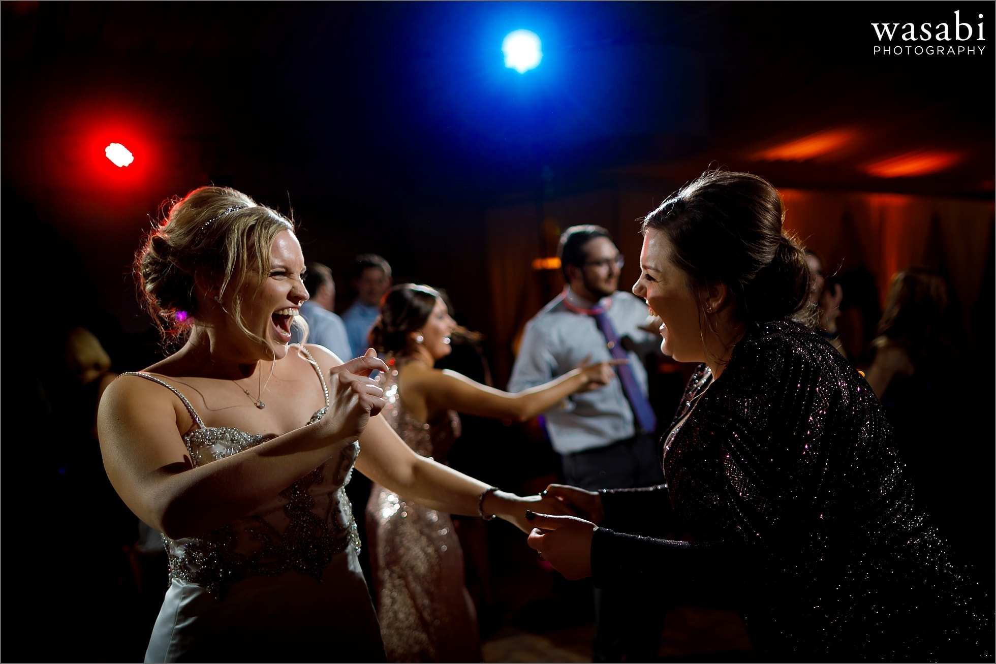 bride and friend dancing during New Years Eve wedding reception at Chicago Marriott Lincolnshire Resort