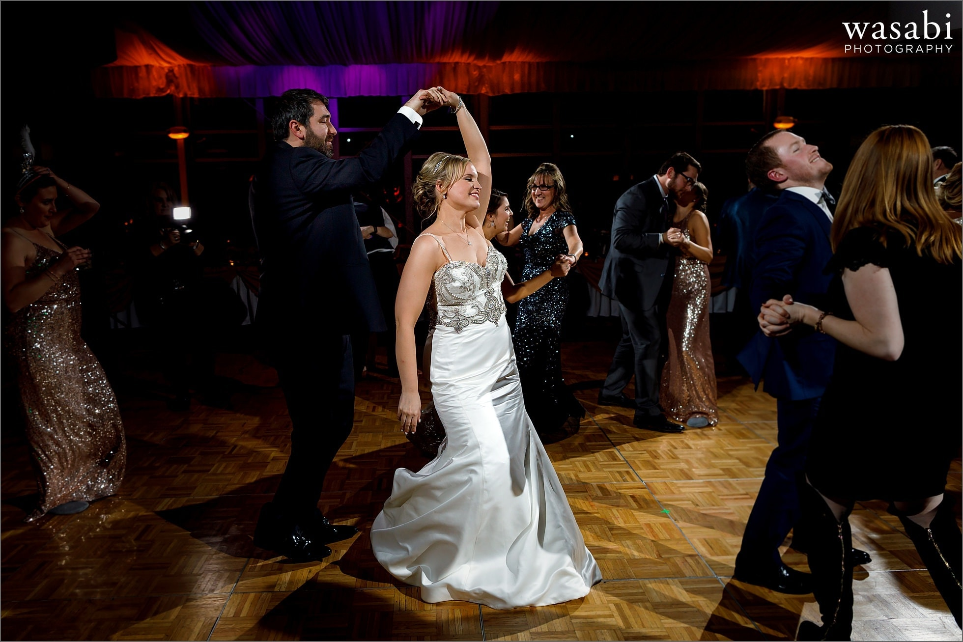 bride and groom dancing during New Years Eve wedding reception at Chicago Marriott Lincolnshire Resort