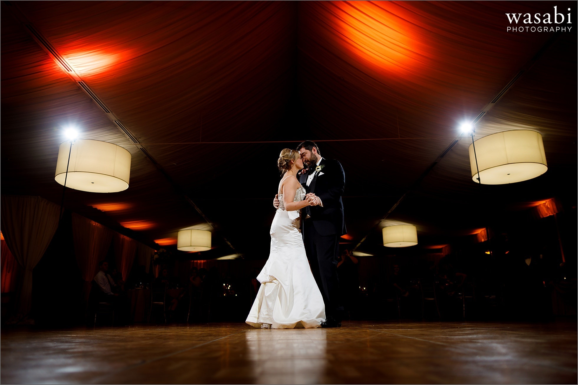 bride and groom first dance with red uplighting during Chicago Marriott Lincolnshire Resort wedding reception