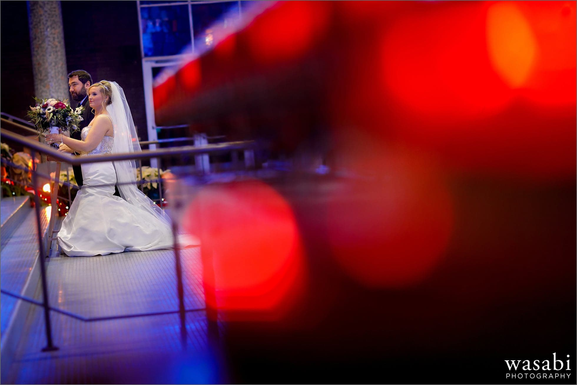 bride and groom kneel at the alter during wedding ceremony at Immaculate Conception Catholic Church in Chicago