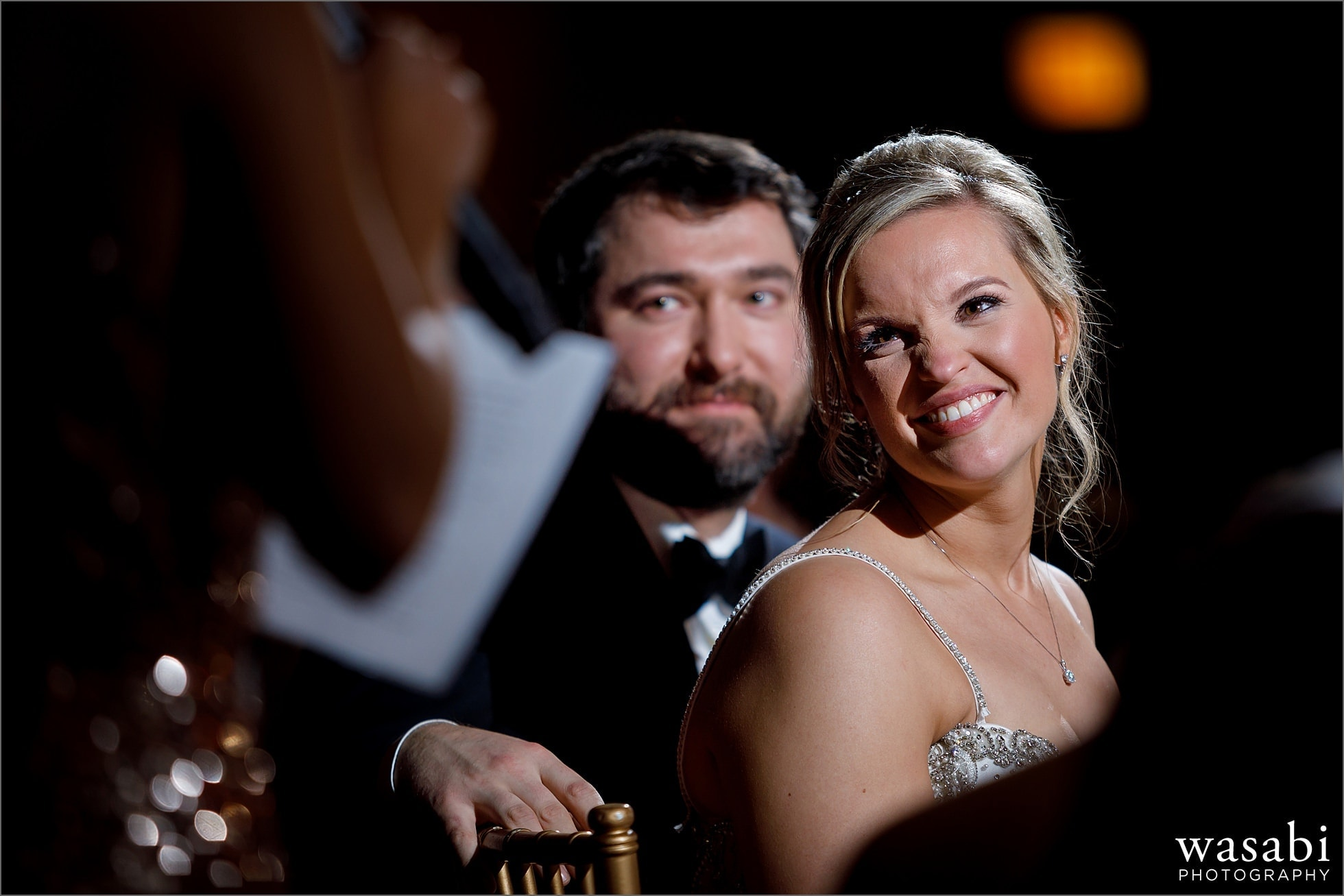 bride and groom listen to maid of honor toast during Chicago Marriott Lincolnshire Resort wedding reception