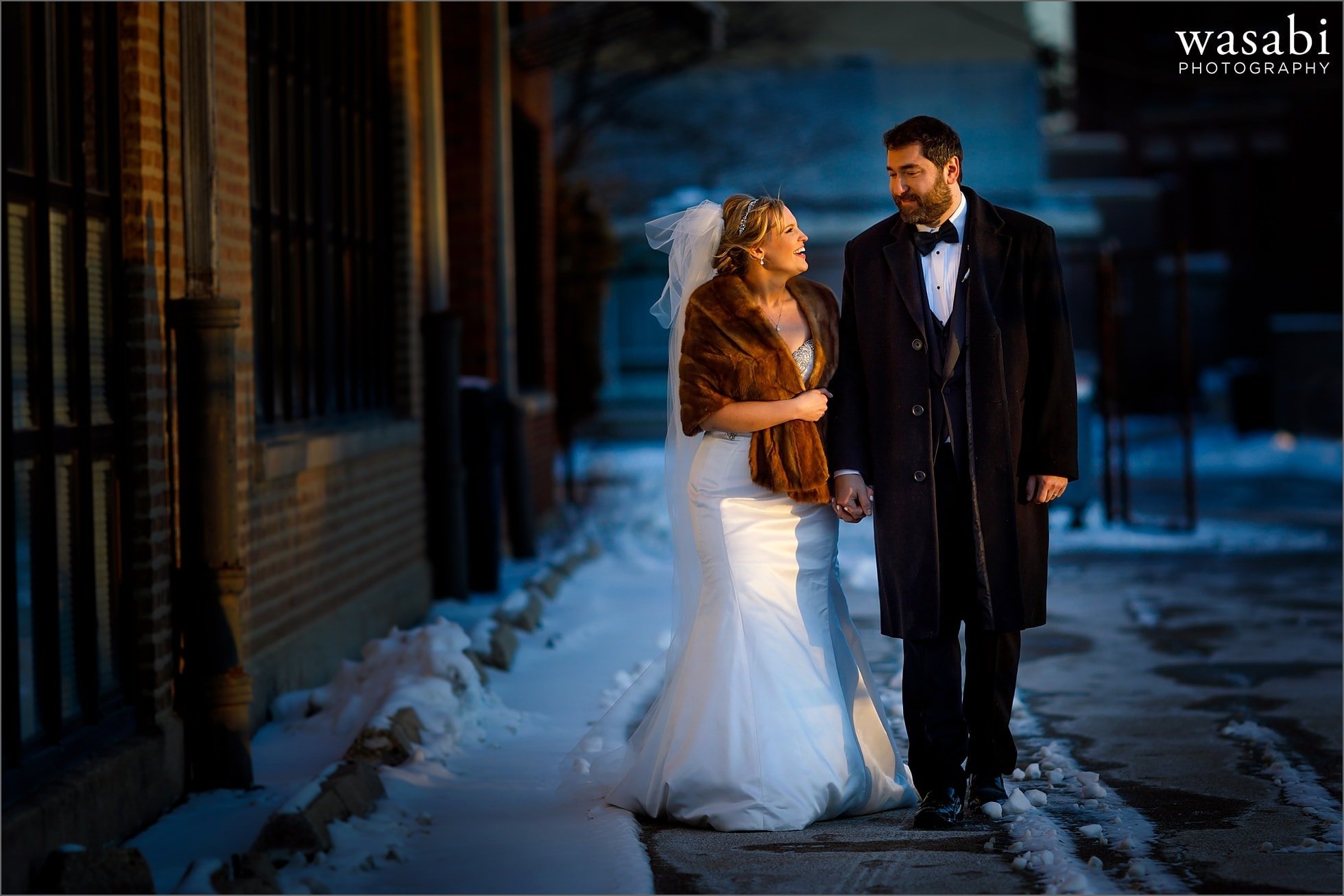 bride and groom portrait outside Immaculate Conception Catholic Church in Chicago at sunset