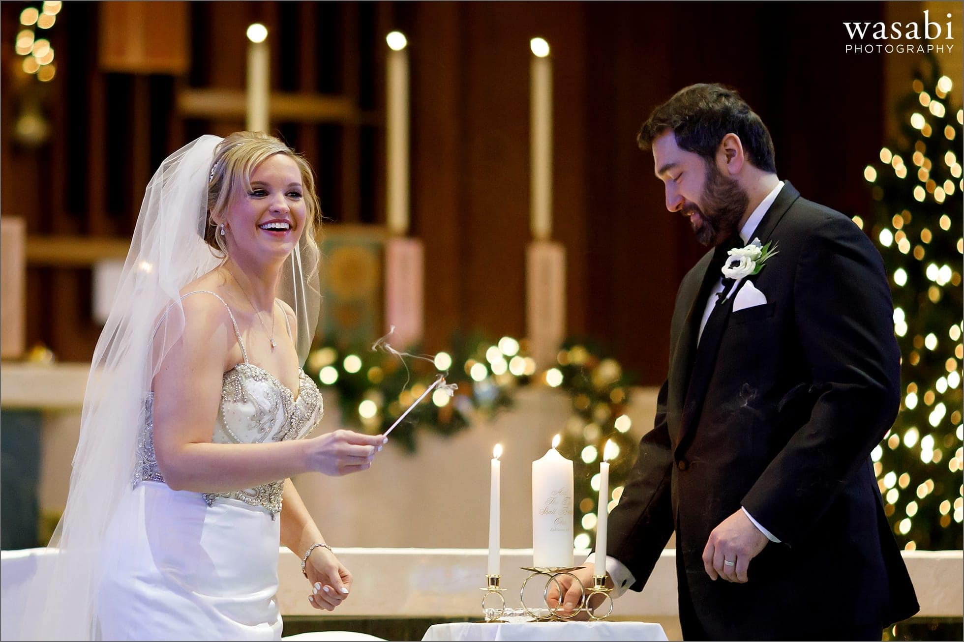 bride blows out candle during wedding ceremony at Immaculate Conception Catholic Church in Chicago