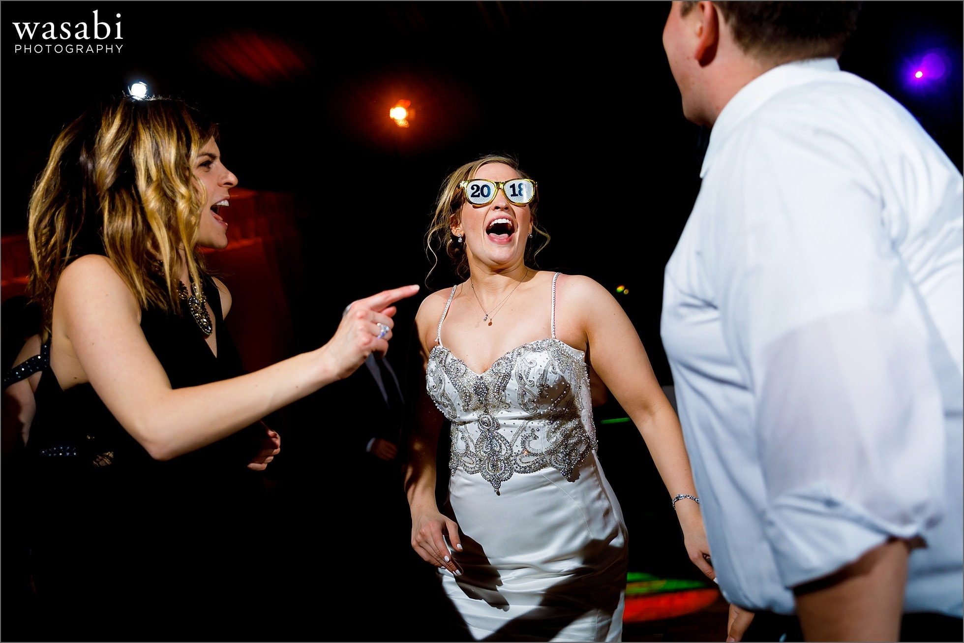 bride dances with 2018 glasses during New Years Eve wedding reception at Chicago Marriott Lincolnshire Resort