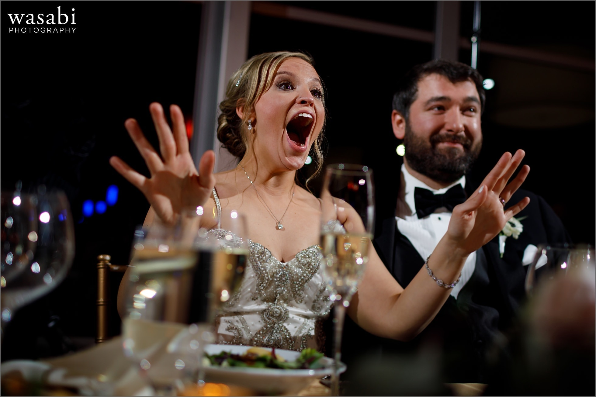 bride reacts with emotion to surprise performance by her cousins during wedding reception