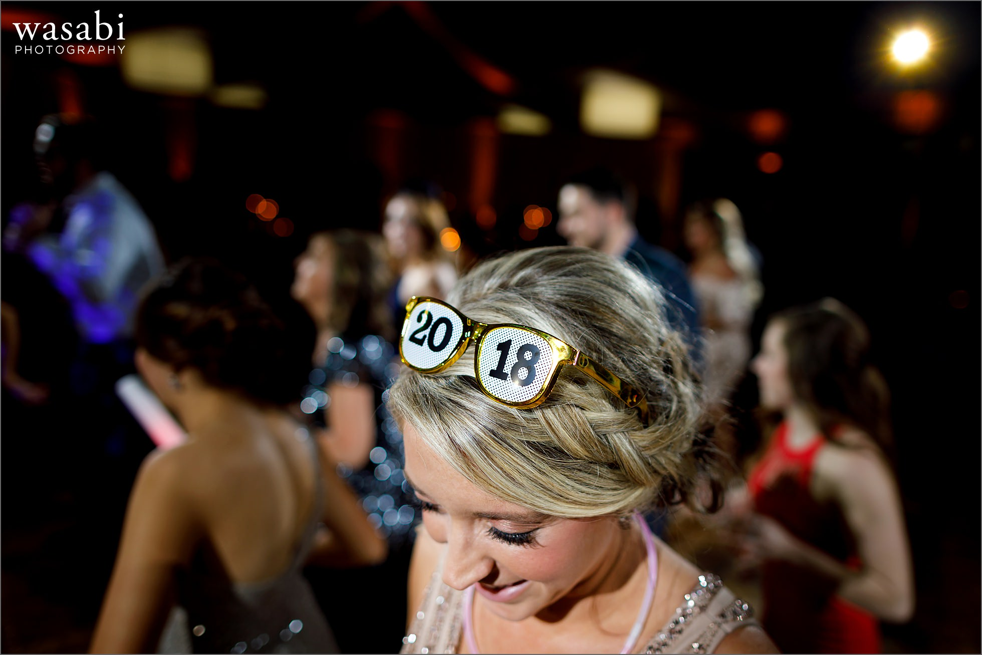 bridesmaid wearing 2018 glasses during New Years Eve wedding reception at Chicago Marriott Lincolnshire Resort