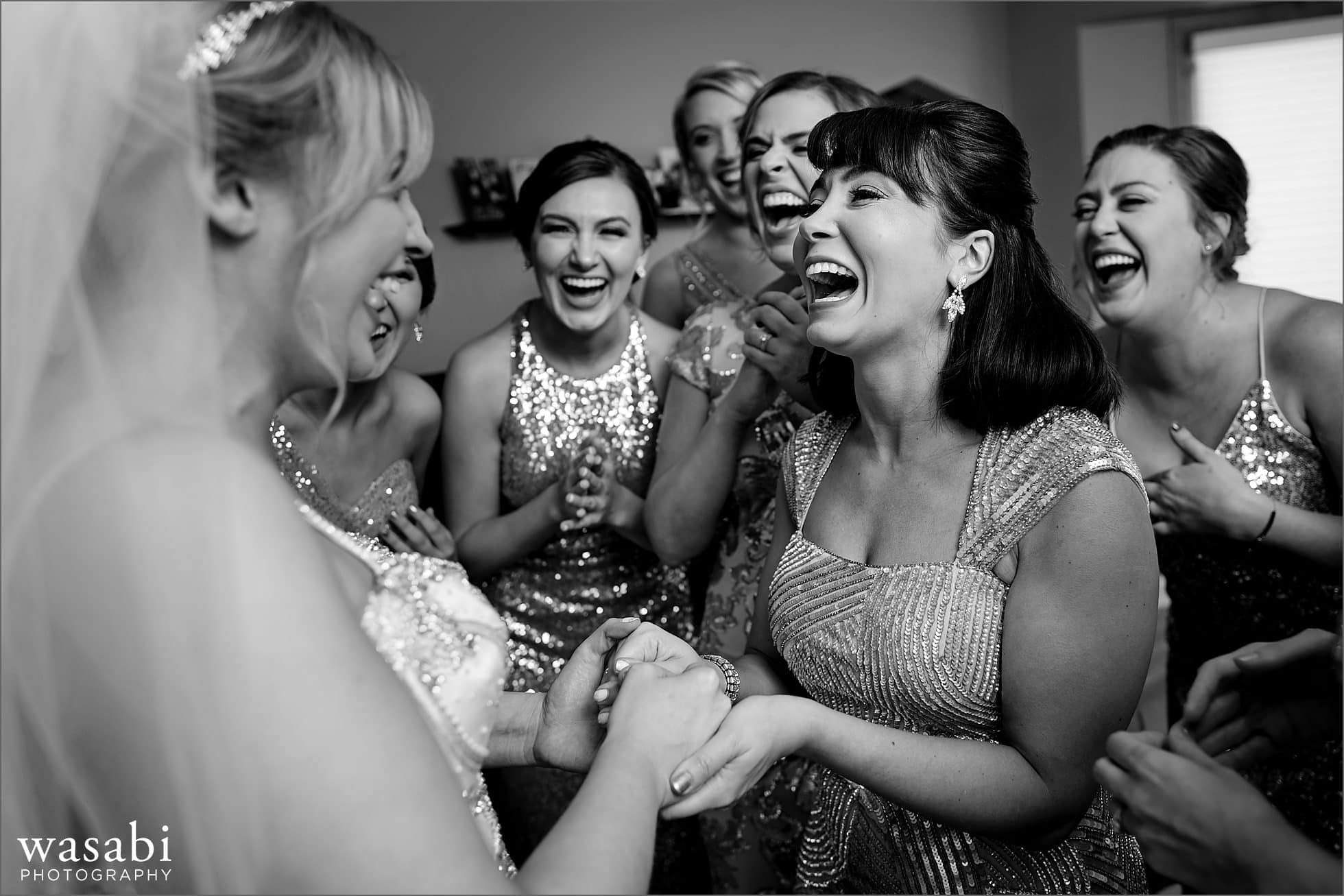 bridesmaids react after seeing bride in wedding dress for the first time