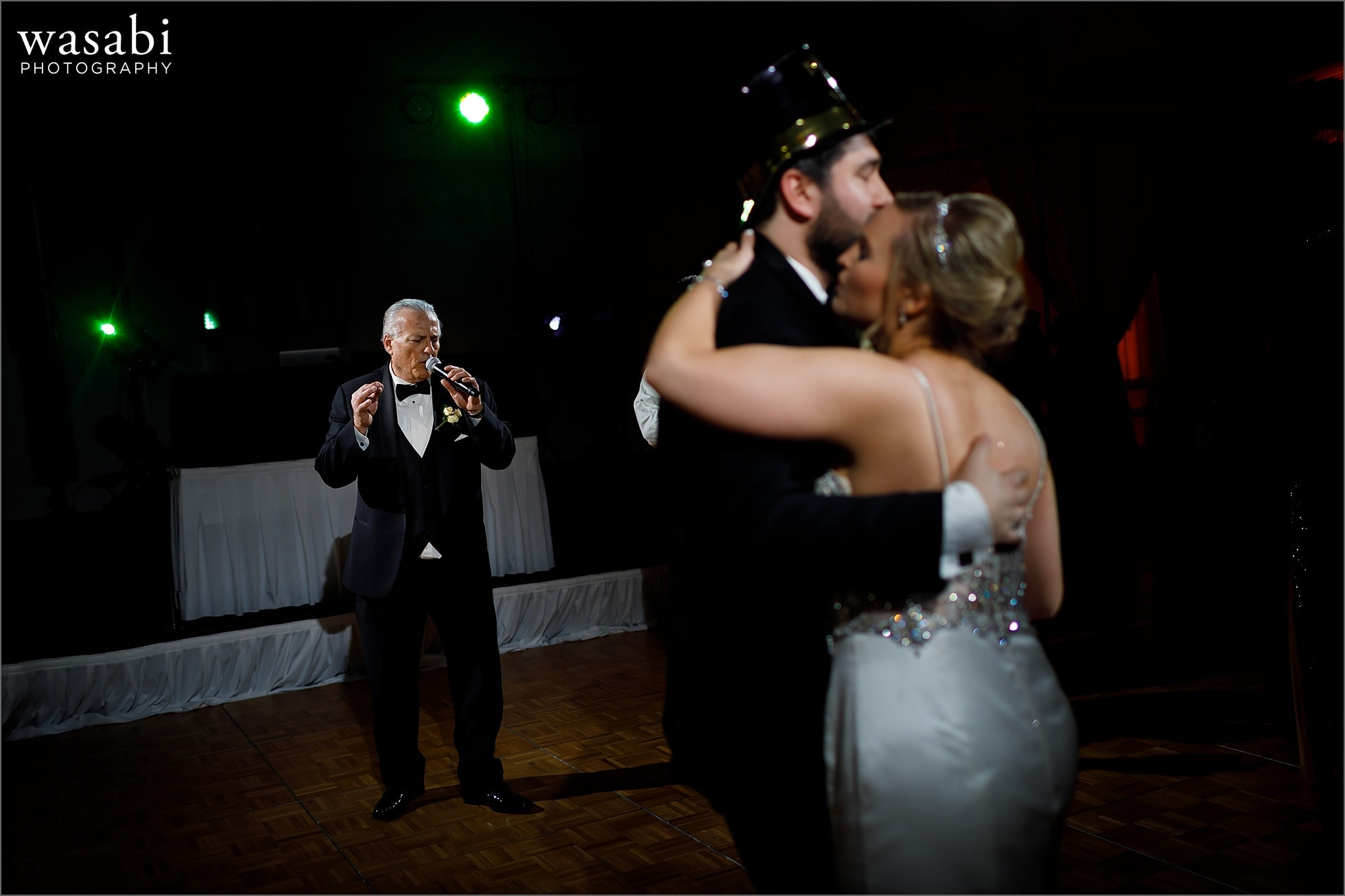 father sings to couple during New Years Eve wedding reception at Chicago Marriott Lincolnshire Resort