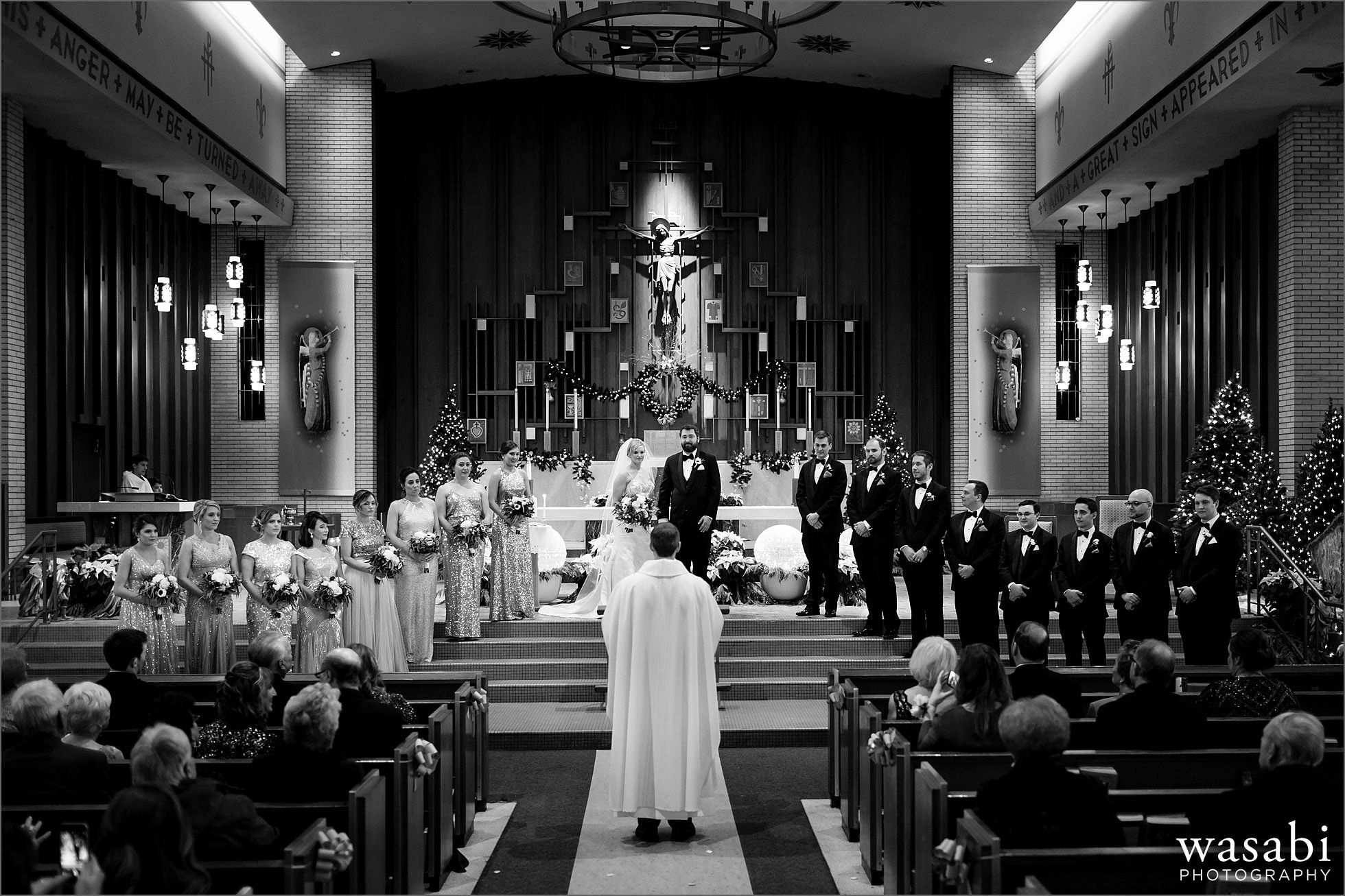 large wedding party during wedding ceremony at Immaculate Conception Catholic Church in Chicago