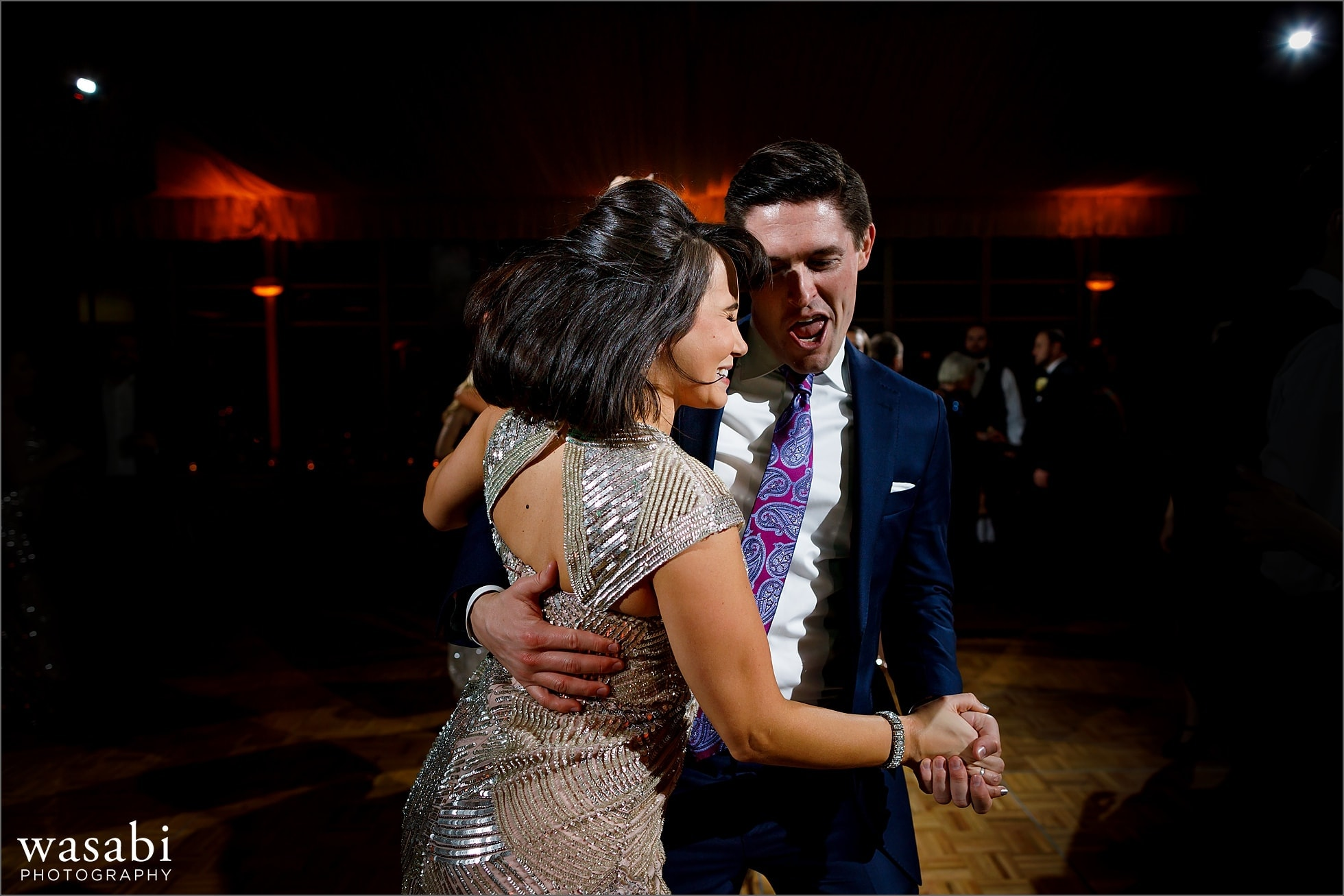 wedding guests dance during New Years Eve wedding reception at Chicago Marriott Lincolnshire Resort
