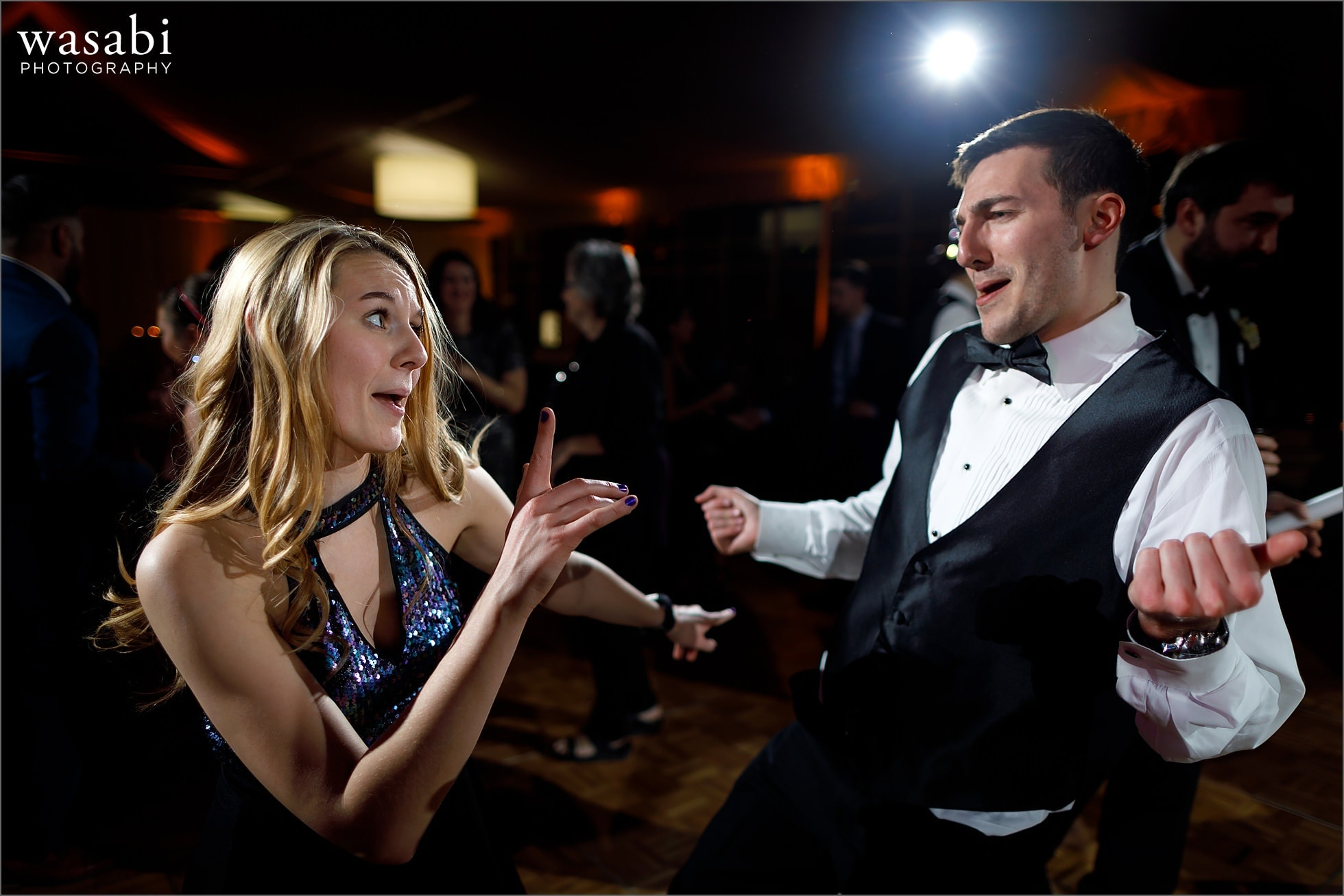 wedding guests dancing during New Years Eve wedding reception at Chicago Marriott Lincolnshire Resort