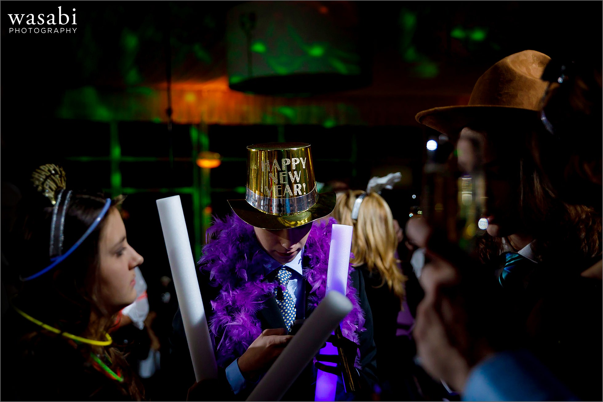 wedding guests wear happy new year hats during New Years Eve wedding reception at Chicago Marriott Lincolnshire Resort