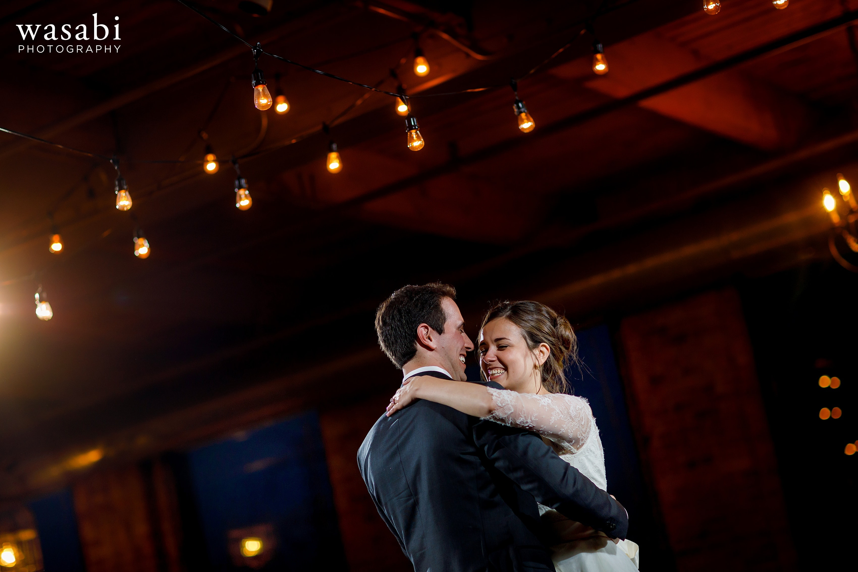 Zoe-&-Justin-share-a-first-dance-during-their-wedding-at-City-View-Loft-in-Chicago-29