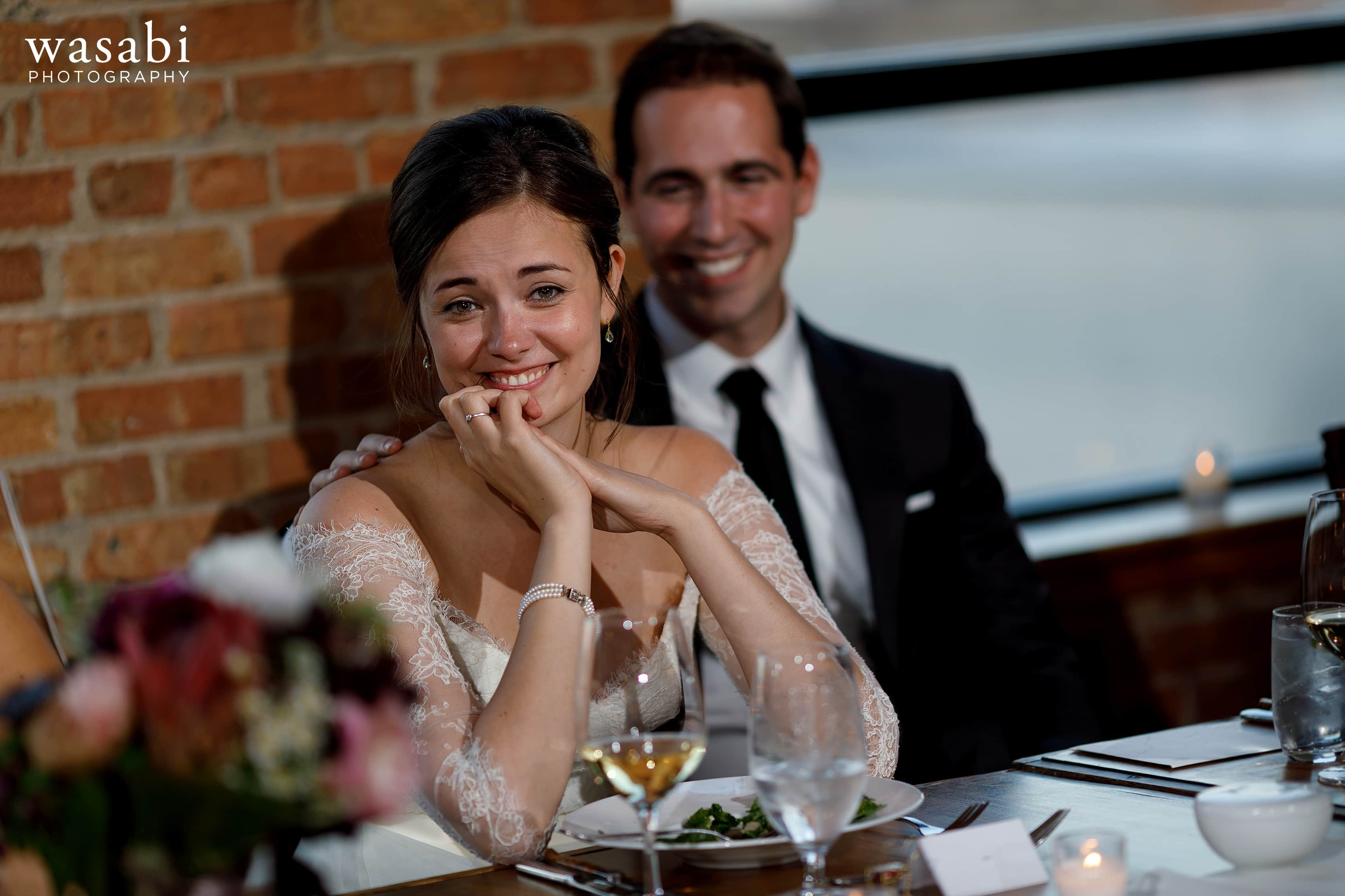 Zoe-and-Justin-listen-to-a-toast-during-a-wedding-reception-at-City-View-Loft-in-Chicago-27