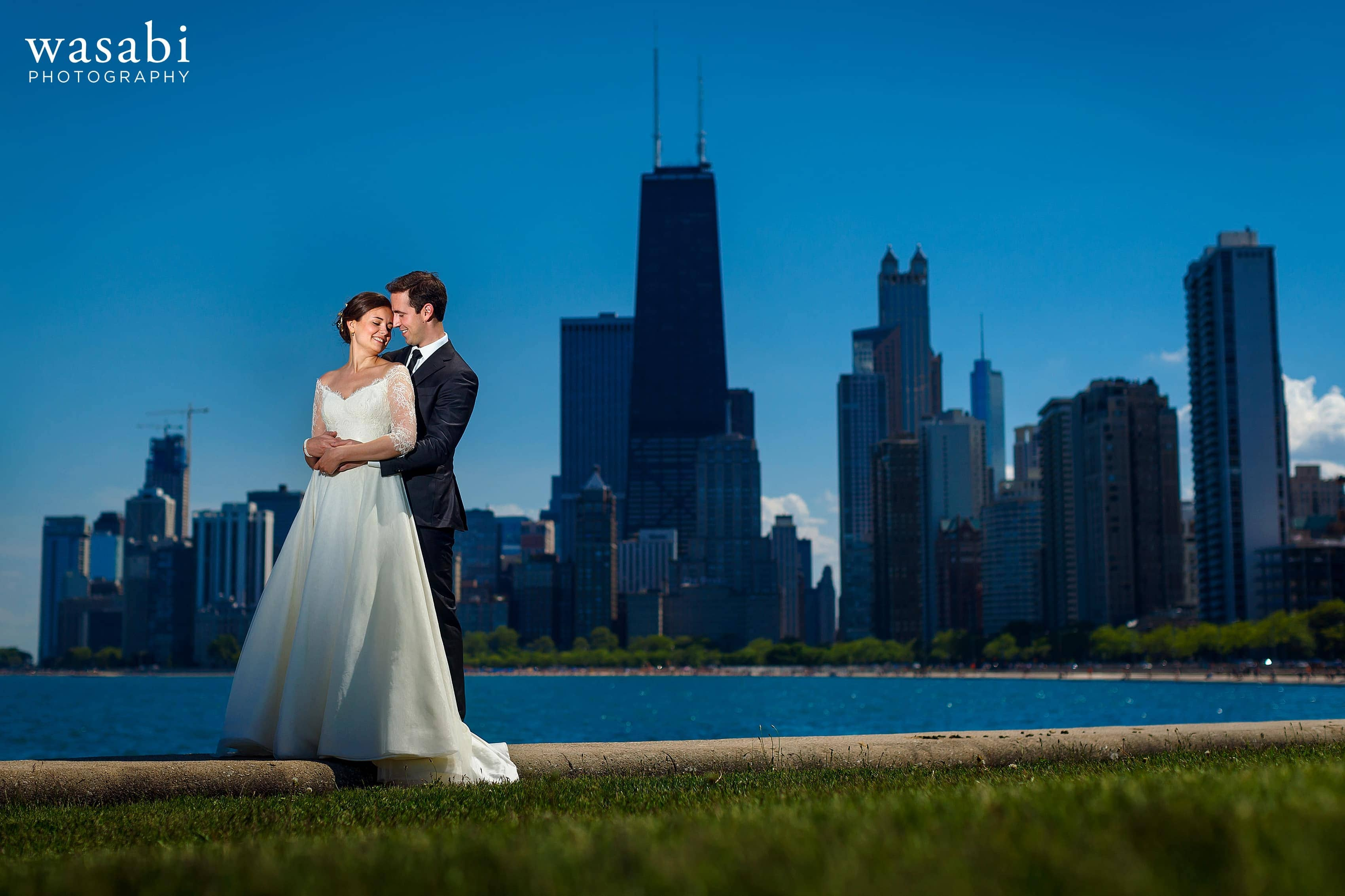 Zoe-and-Justin-pose-for-a-lit-portrait-at-North-Avenue-Beach-with-the-Chicago-skyline-in-the-background-on-their-wedding-day-13