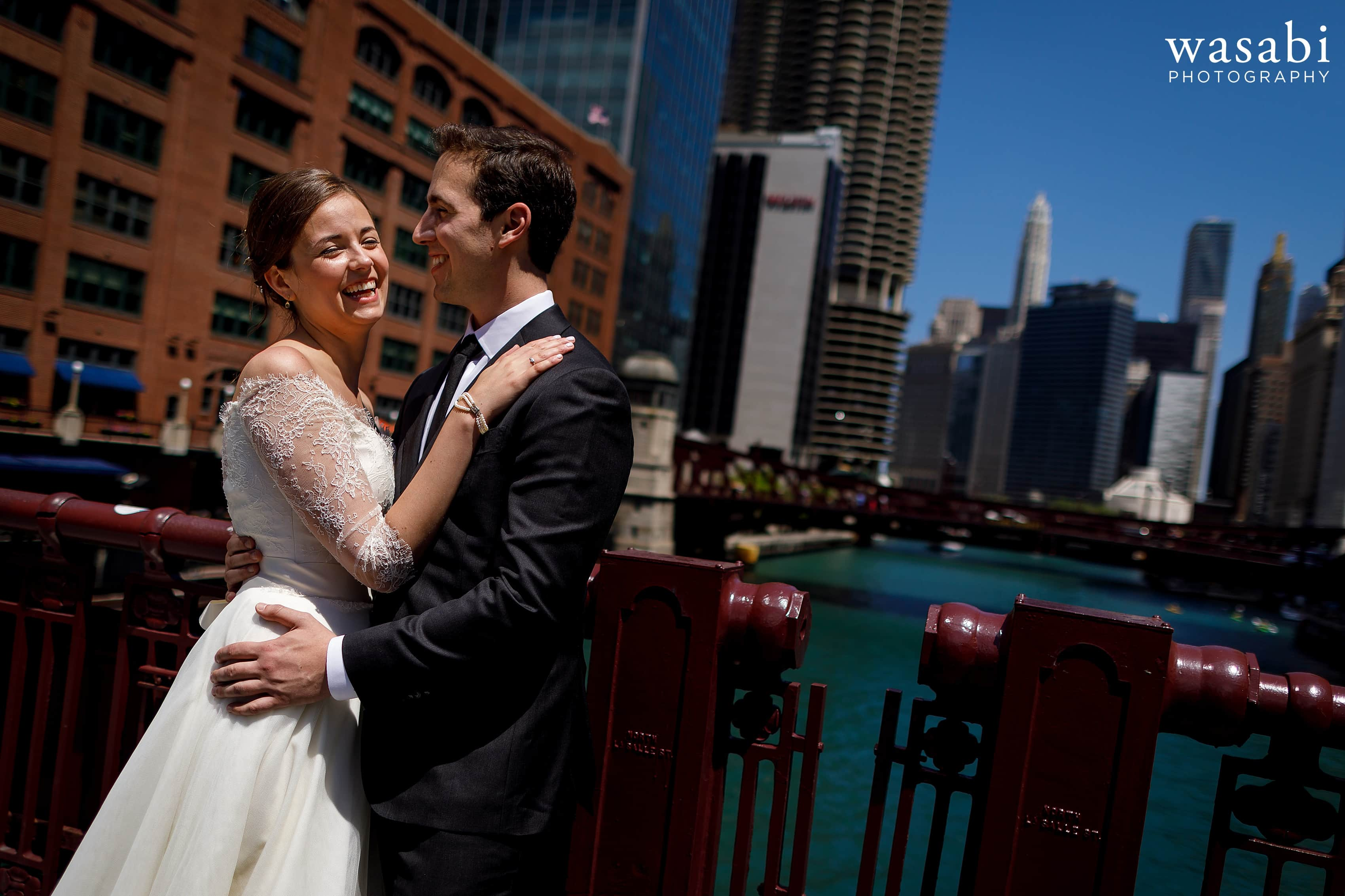 Zoe-and-Justin-pose-for-a-portrait-on-LaSalle-Street-Bridge-with-the-Chicago-River-and-skyline-in-the-background-11