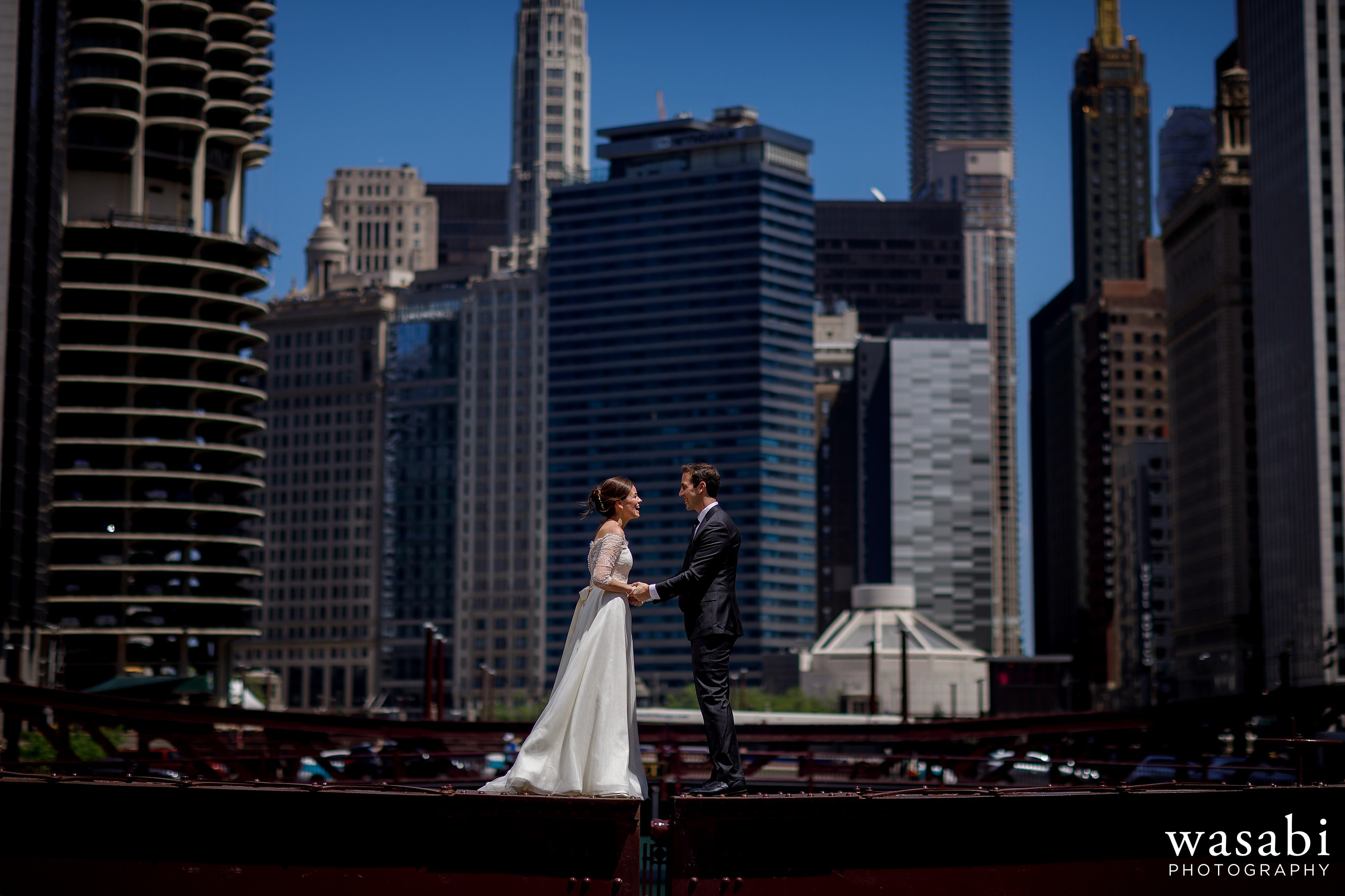 Zoe-and-Justin-pose-for-a-portrait-while-standing-on-top-of-the-LaSalle-Street-Bridge-with-the-Chicago-skyline-in-the-background-12