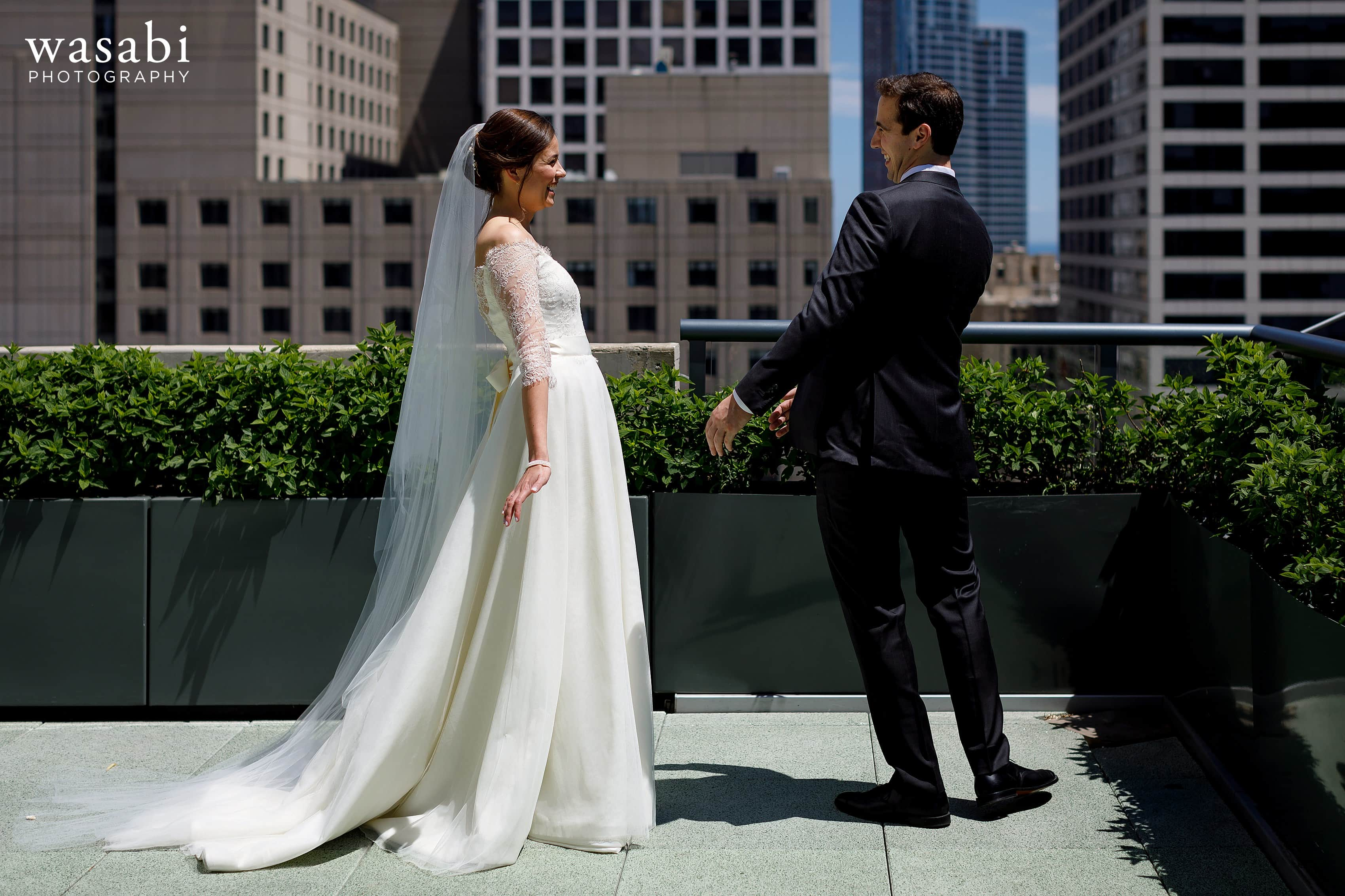Zoe-and-Justin-react-to-seeing-each-other-during-a-first-look-on-top-of-Hotel-Palomar-in-Chicago-08