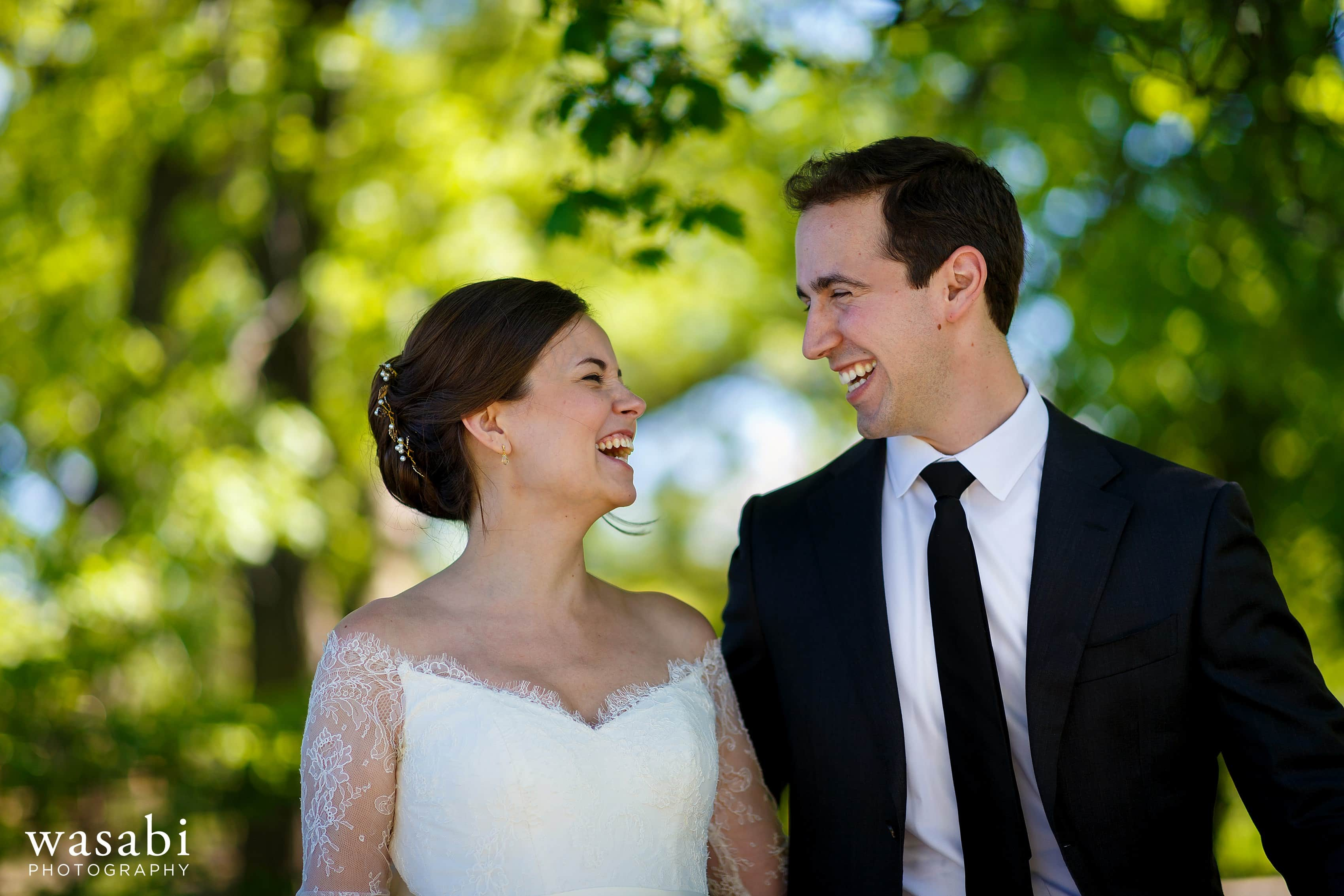 Zoe-and-Justin-walk-through-the-Alfred-Caldwell-Lily-Pool-at-Lincoln-Park-Conservancy-on-their-wedding-day-14