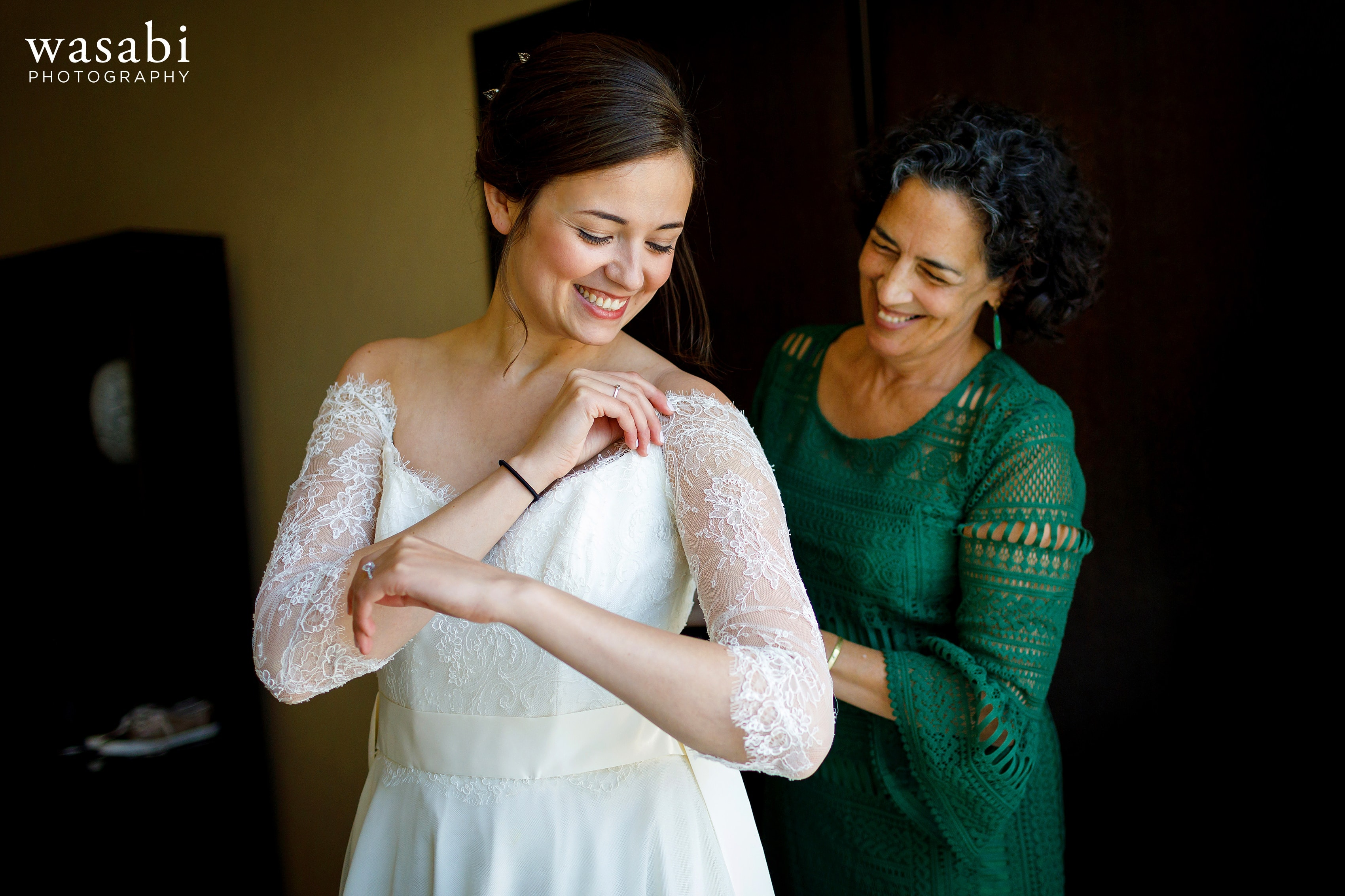 Zoe-is-helped-into-her-wedding-dress-while-getting-ready-at-Hotel-Palomar-in-Chicago-06
