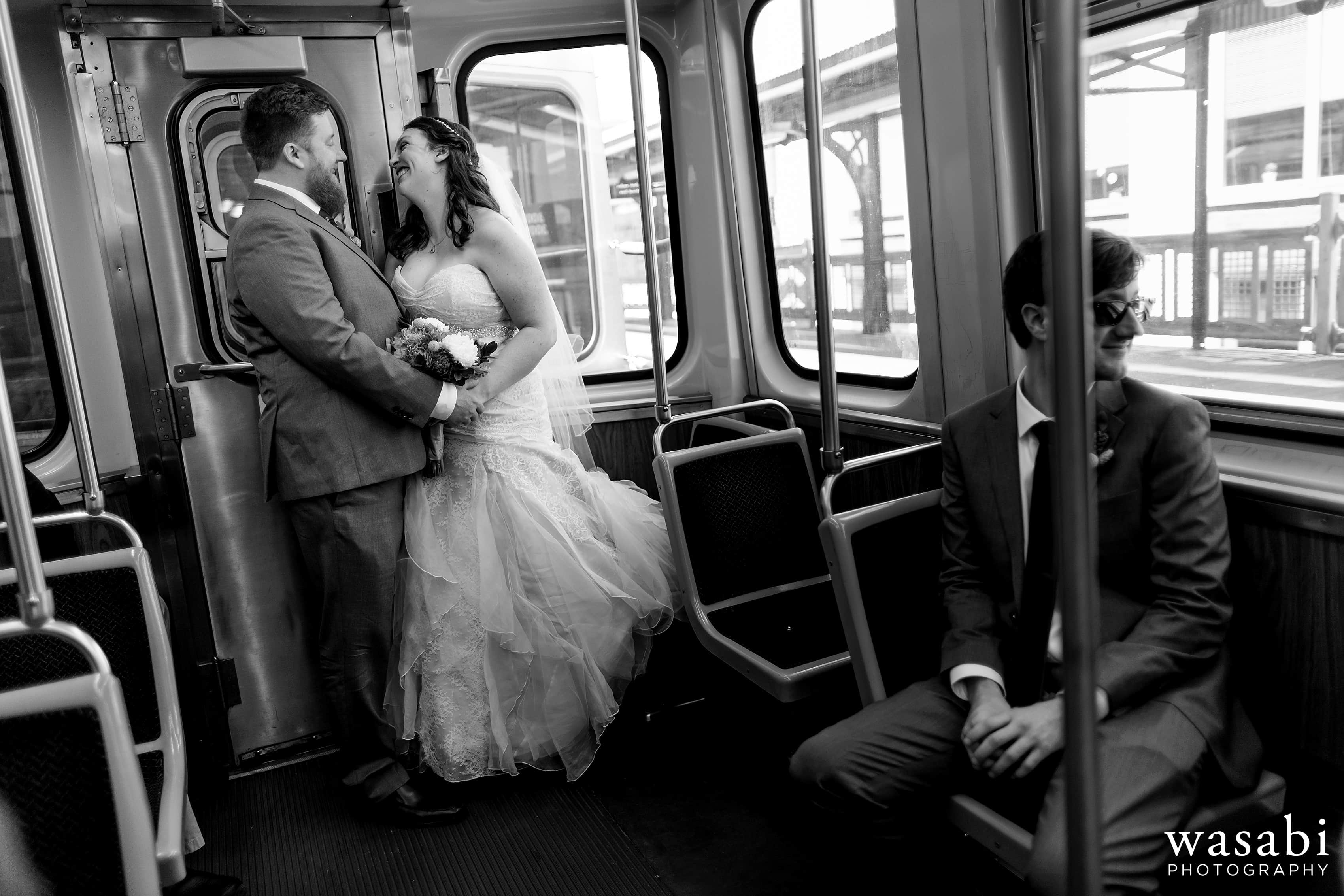 A bride and groom ride the red line El train to their wedding at Loft on Lake in Chicago