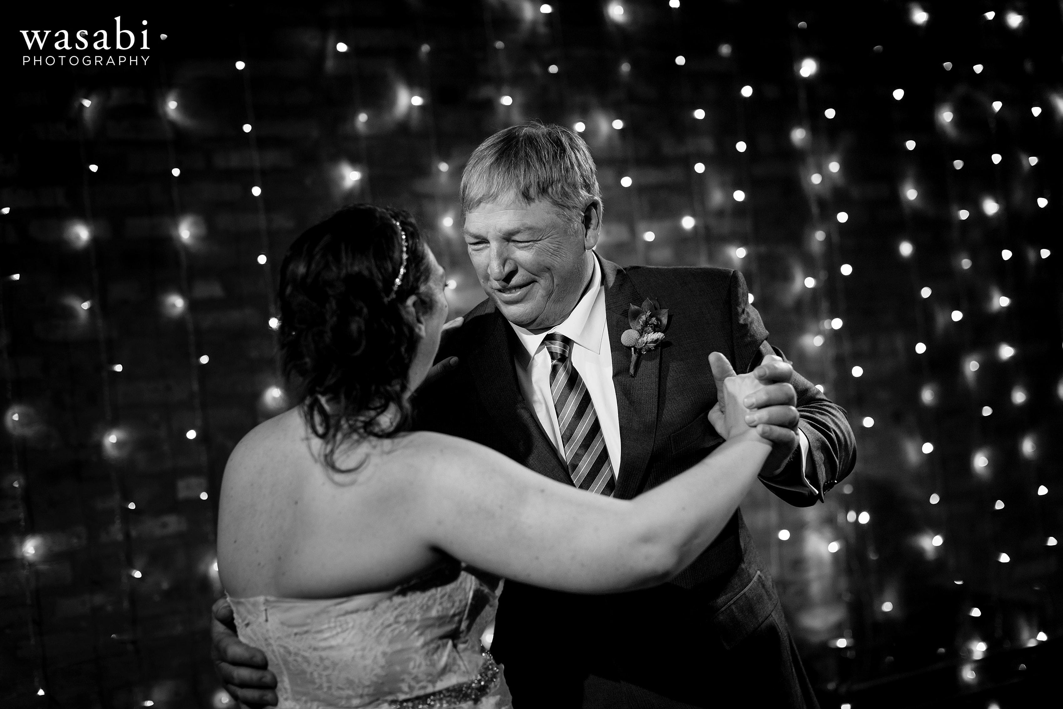 A bride dances with her father during a Loft on Lake wedding reception