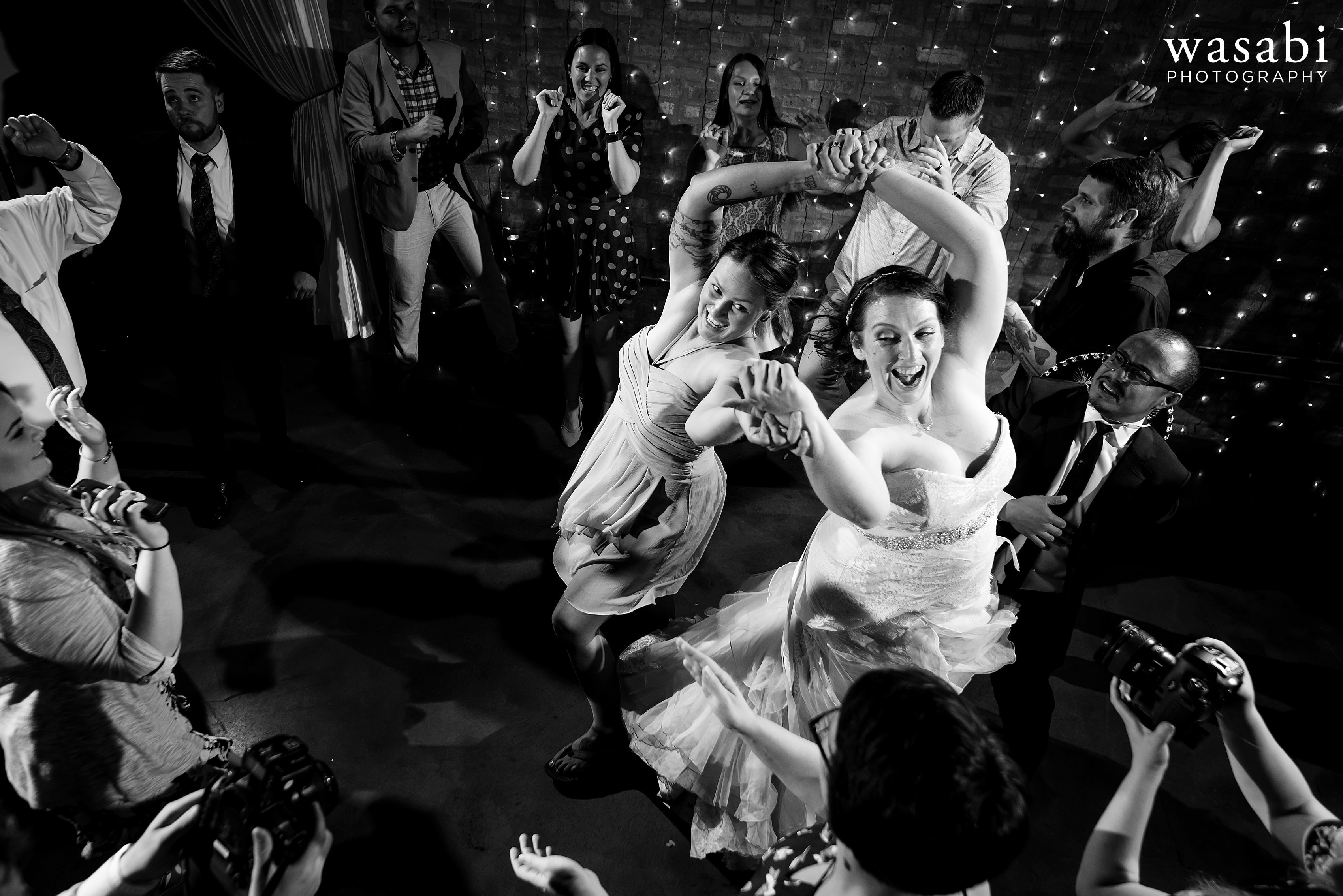 A bride dances with her guests during a Loft on Lake wedding reception