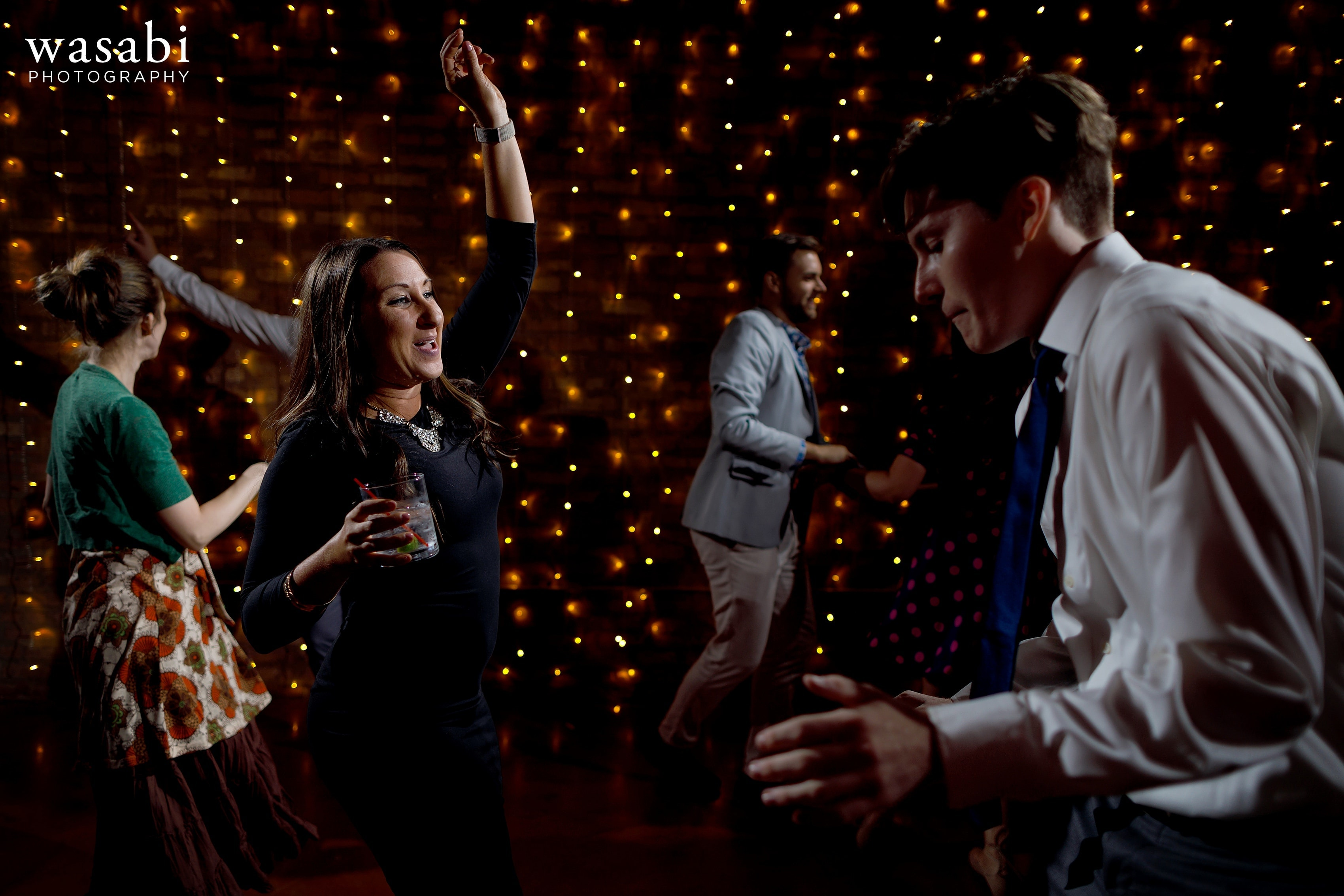 Guests dance during a Loft on Lake wedding reception