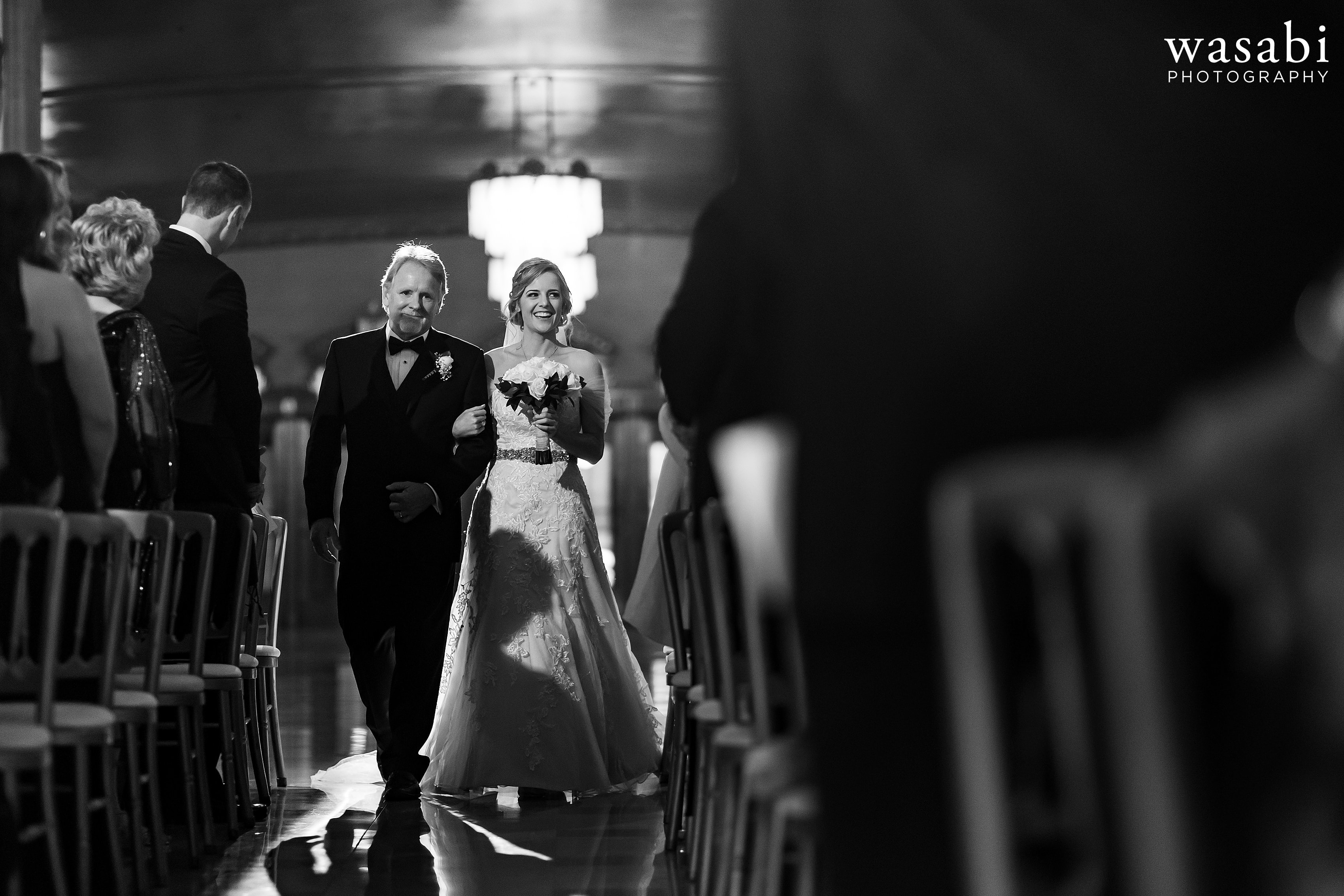 Bride and father walk down the aisle wedding at Civic Opera House in Chicago
