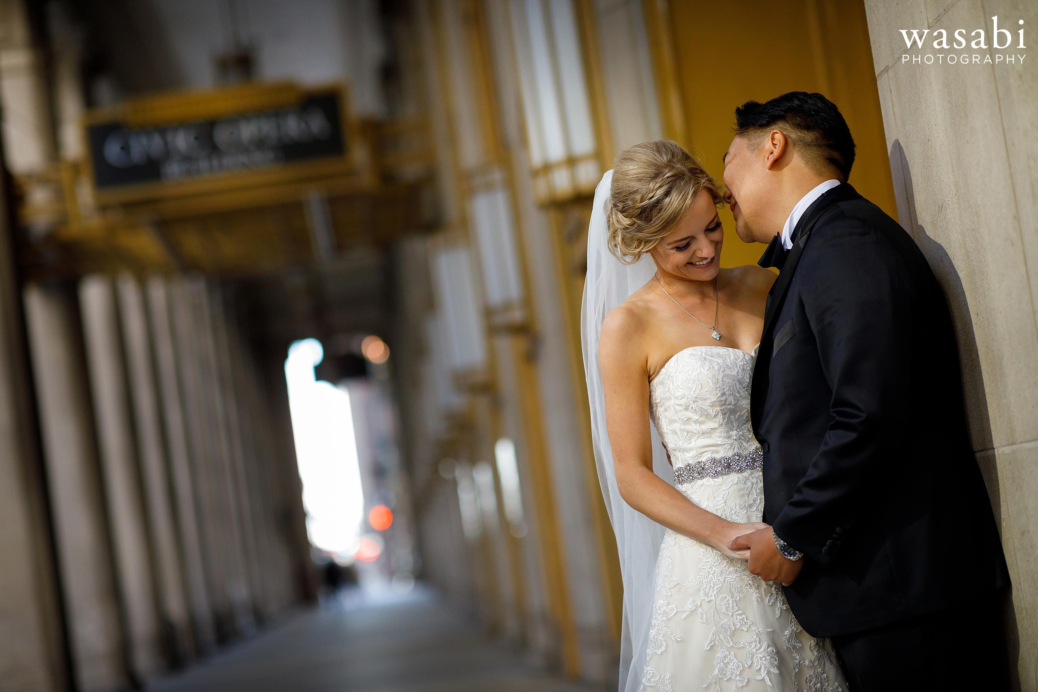 Bride and groom portrait outside Civic Opera Building in Chicago