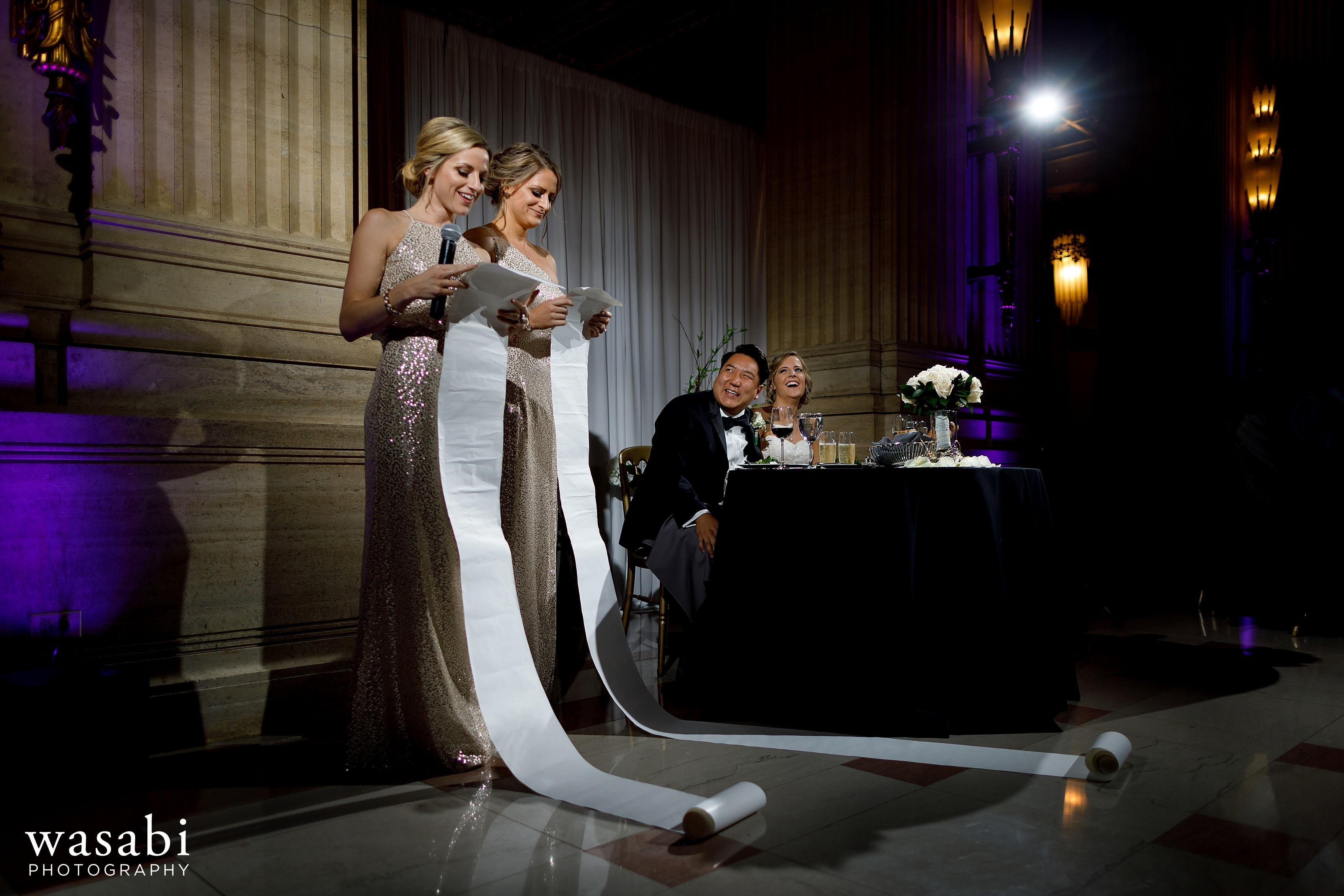 Bridesmaid sisters read long scrolls as joke during toasts at Civic Opera House wedding reception in Chicago