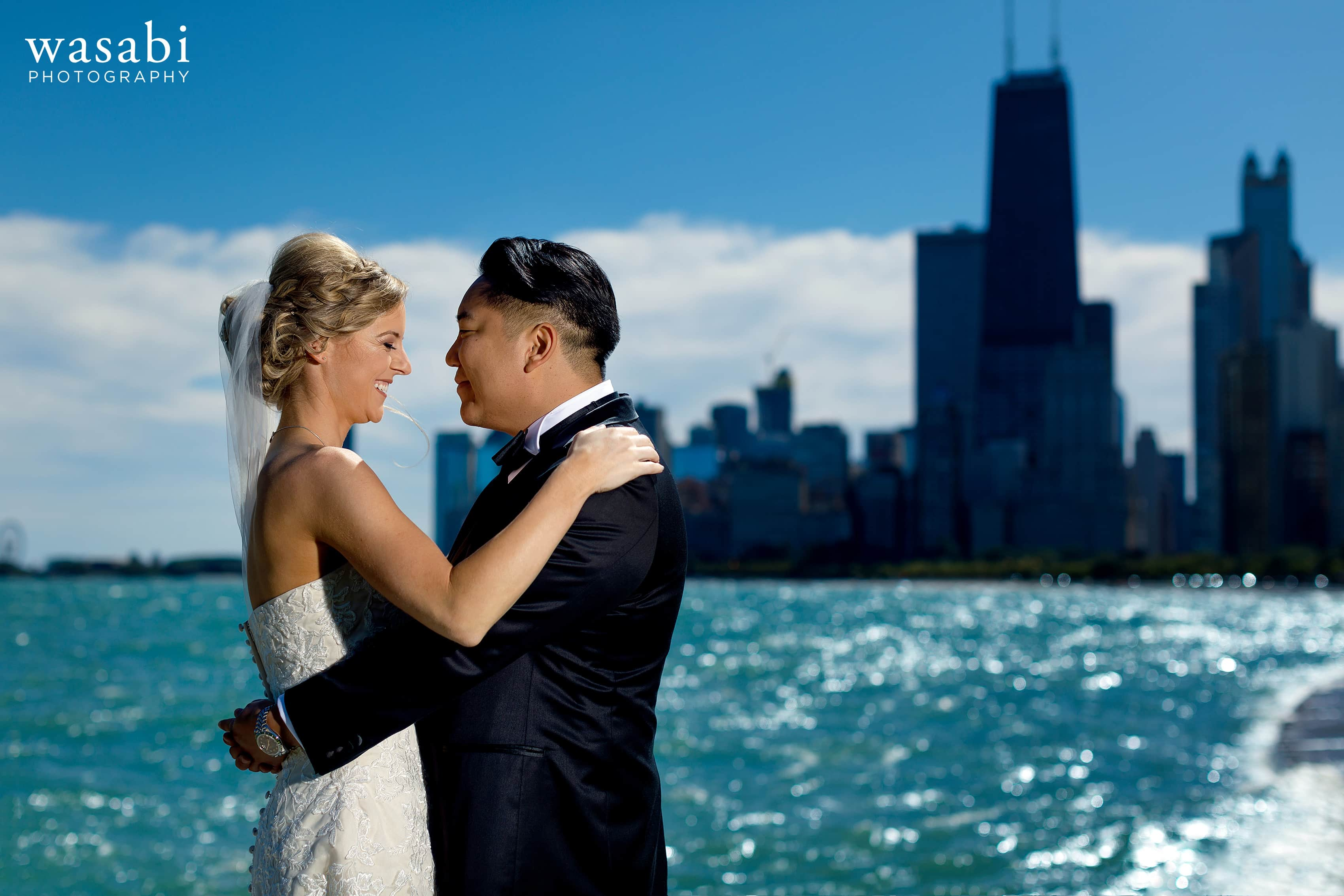 Lit portrait in full sun of bride and groom portrait at North Avenue Beach in Chicago