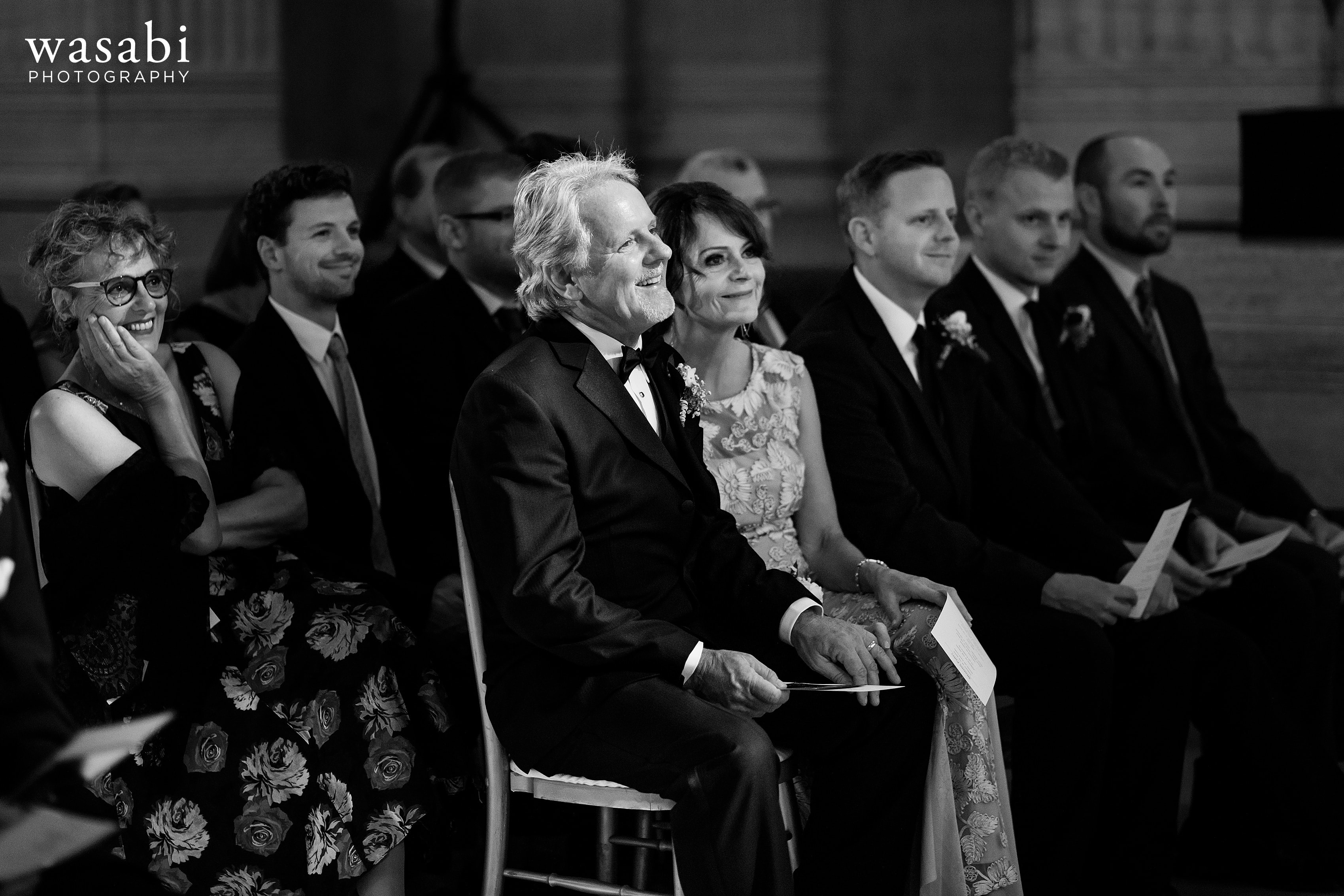 Parents watch wedding ceremony at Civic Opera House in Chicago