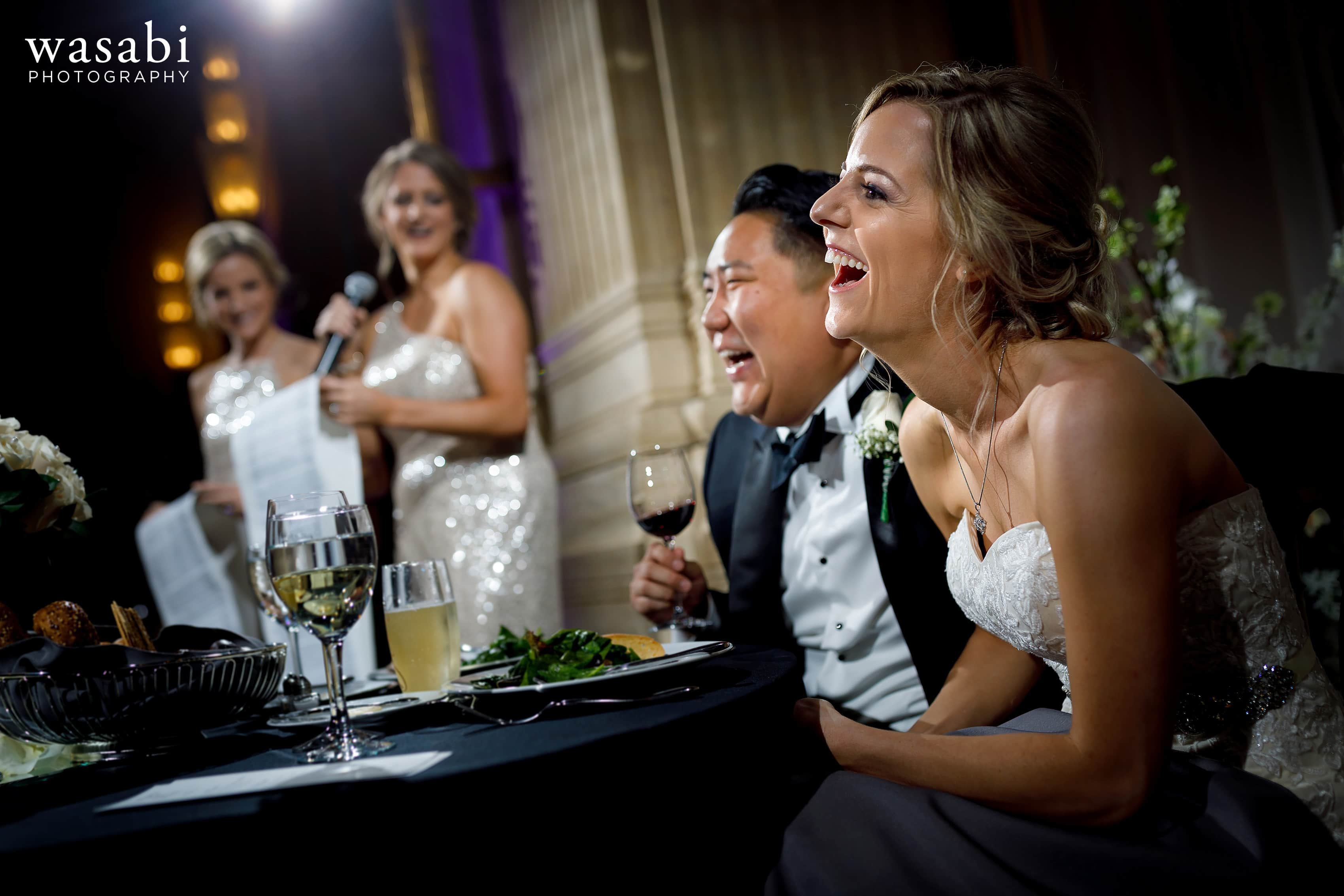 bride laughs during toasts at Civic Opera House wedding reception in Chicago