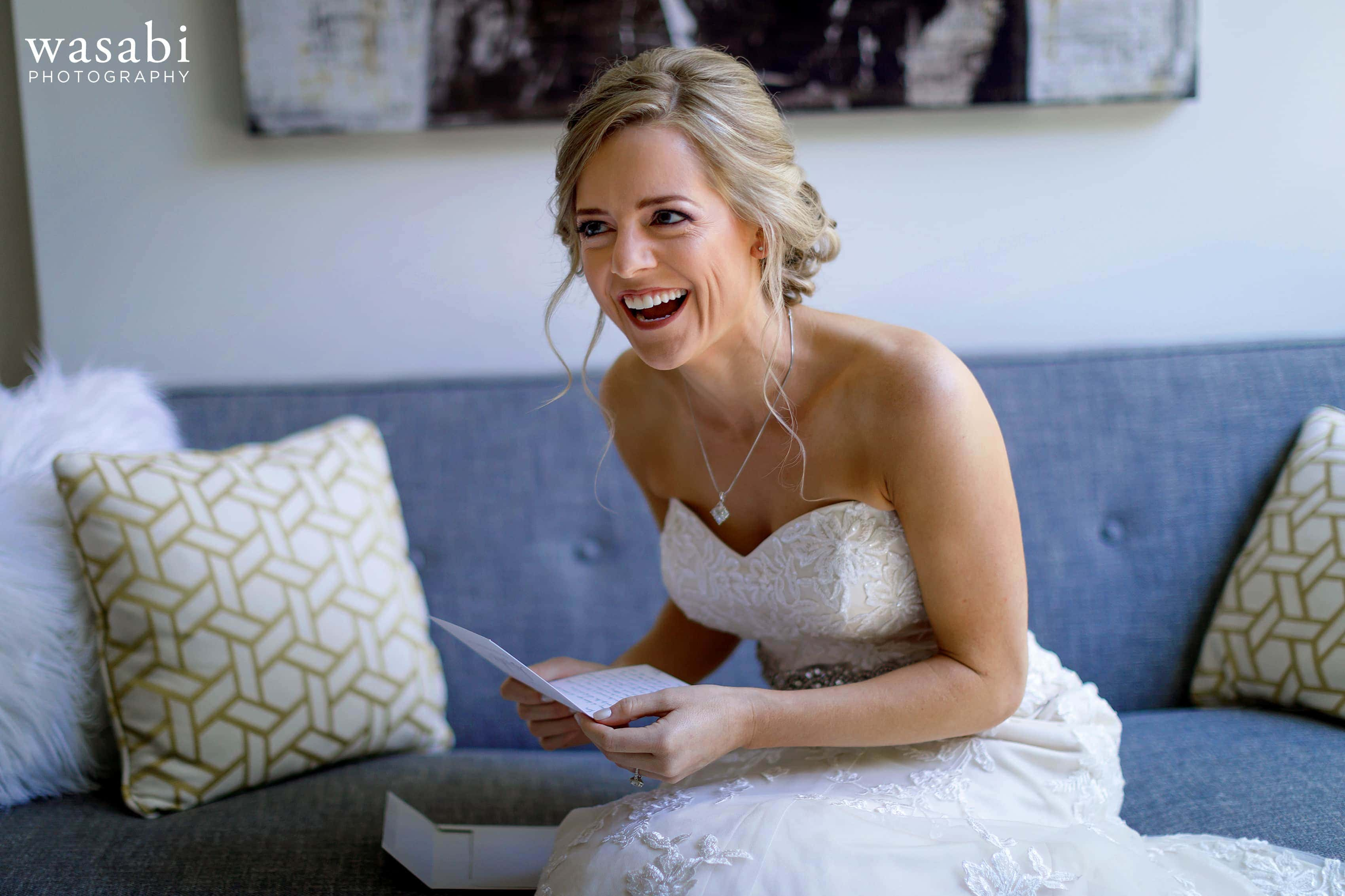 bride laughs while reading letter from her groom