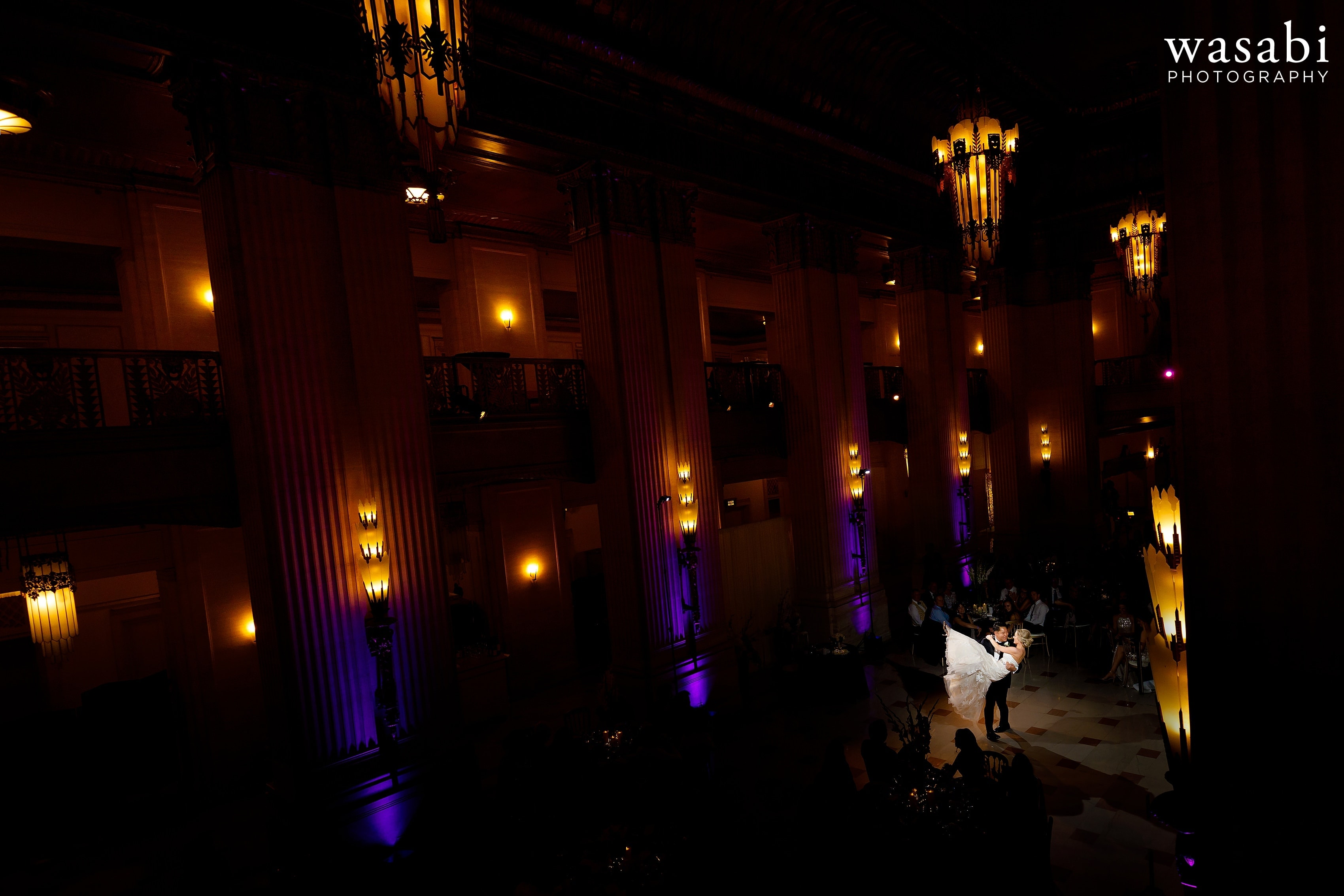 epic wide angle view from upstairs showing the grand lobby during Civic Opera House wedding reception in Chicago