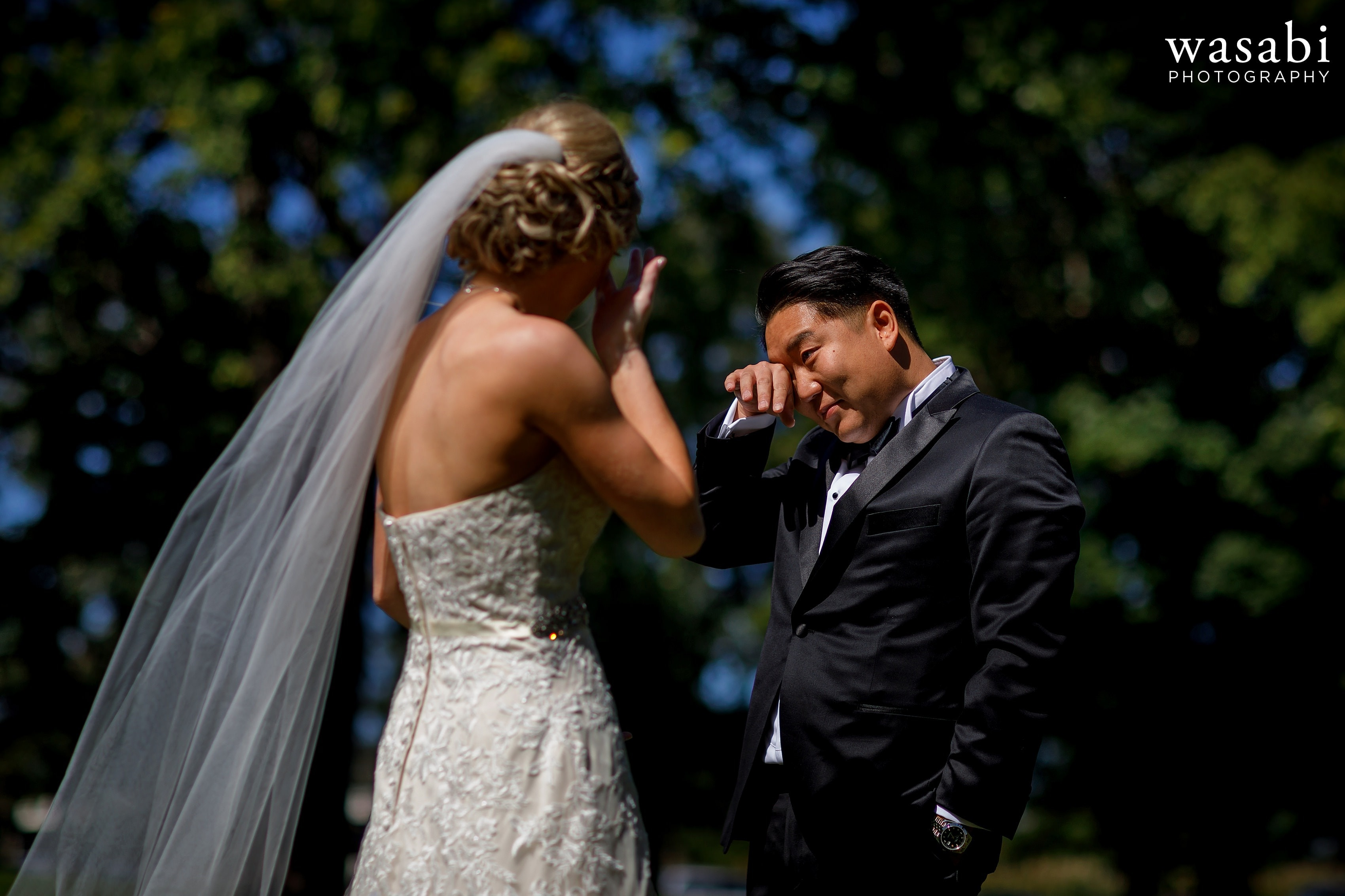 first look reaction of groom to seeing bride outside full sun