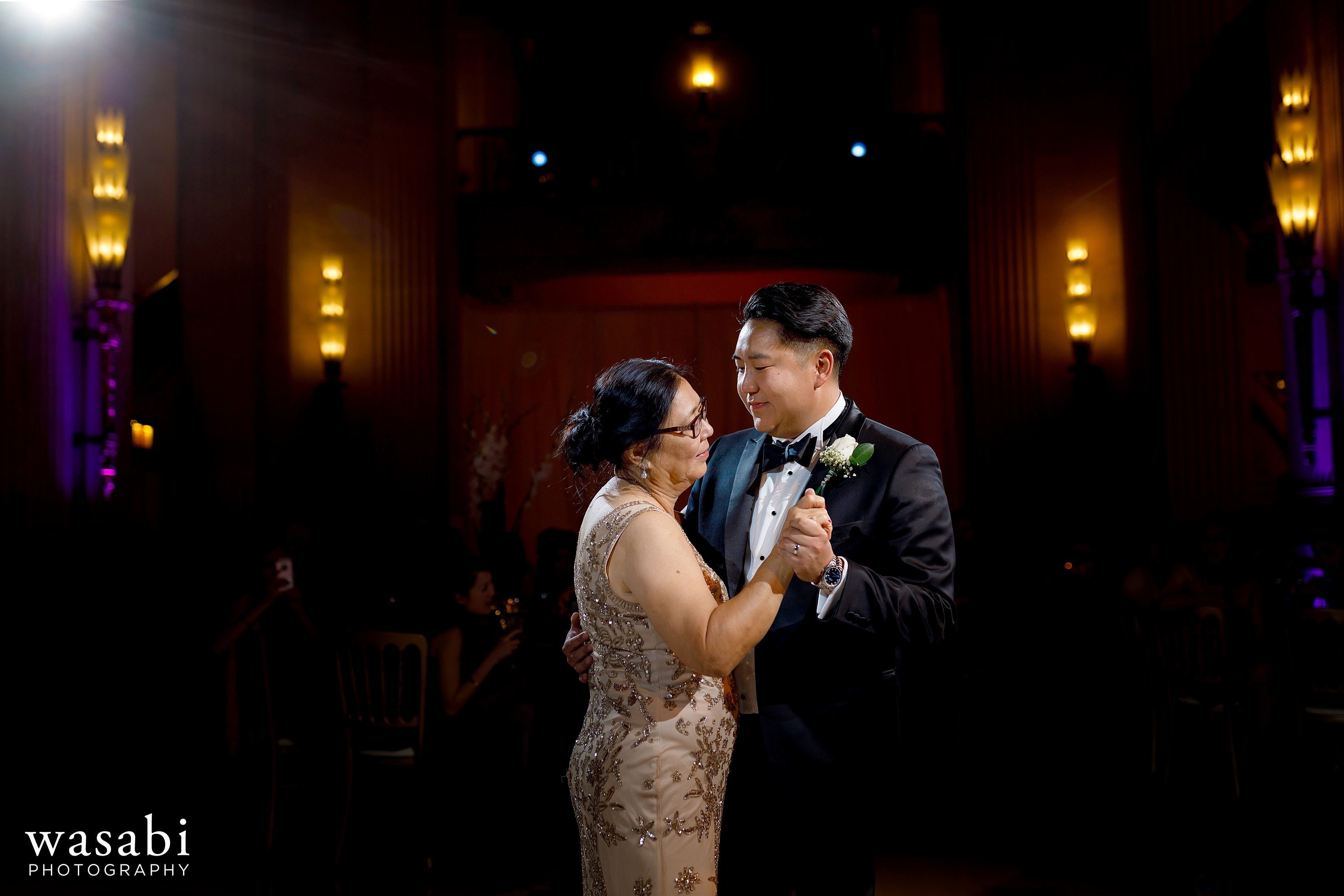 groom dances with mom during Civic Opera House Wedding reception in Chicago