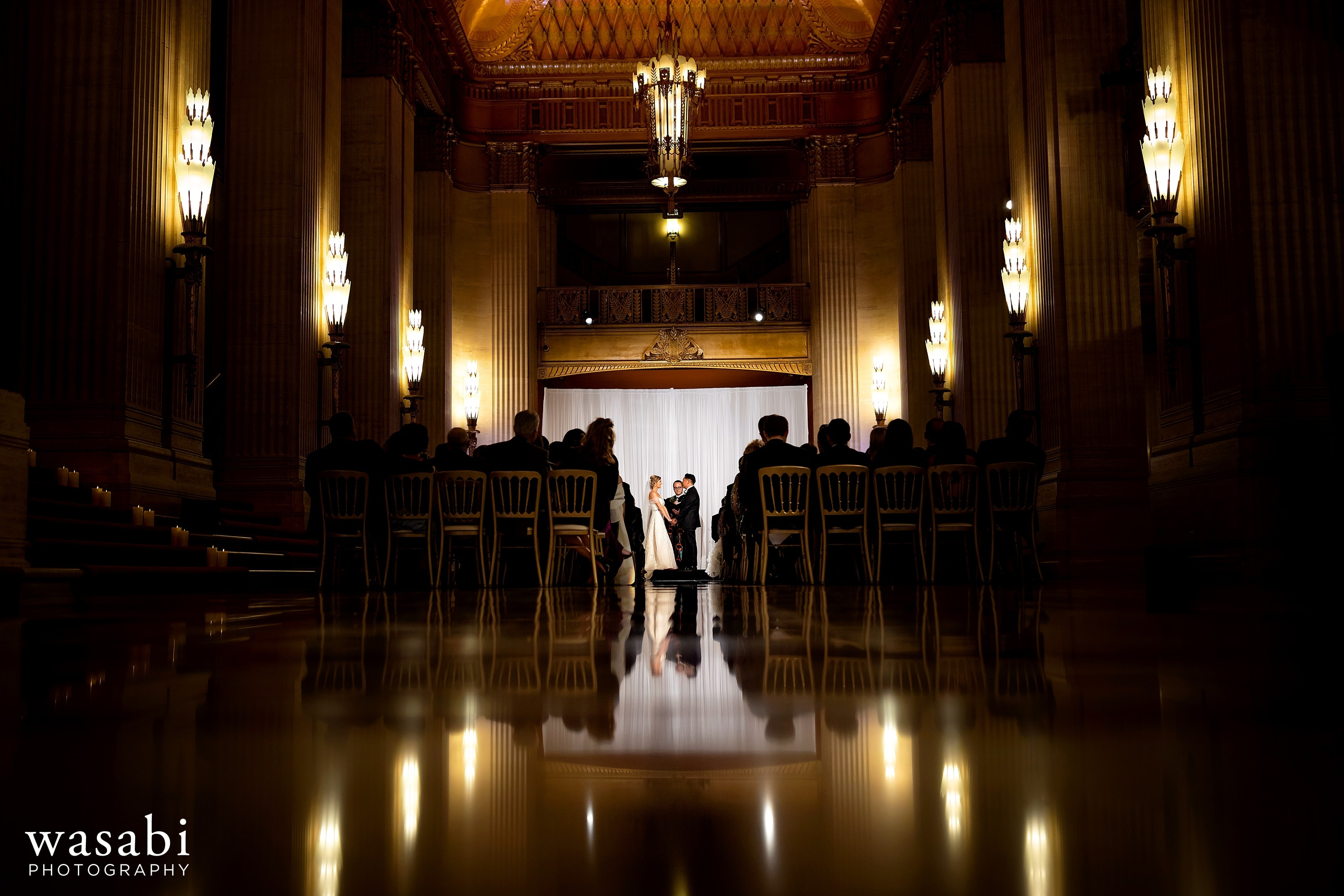 wide angle view with reflection showing the ceiling of Civic Opera House wedding ceremony showing the entire grand lobby