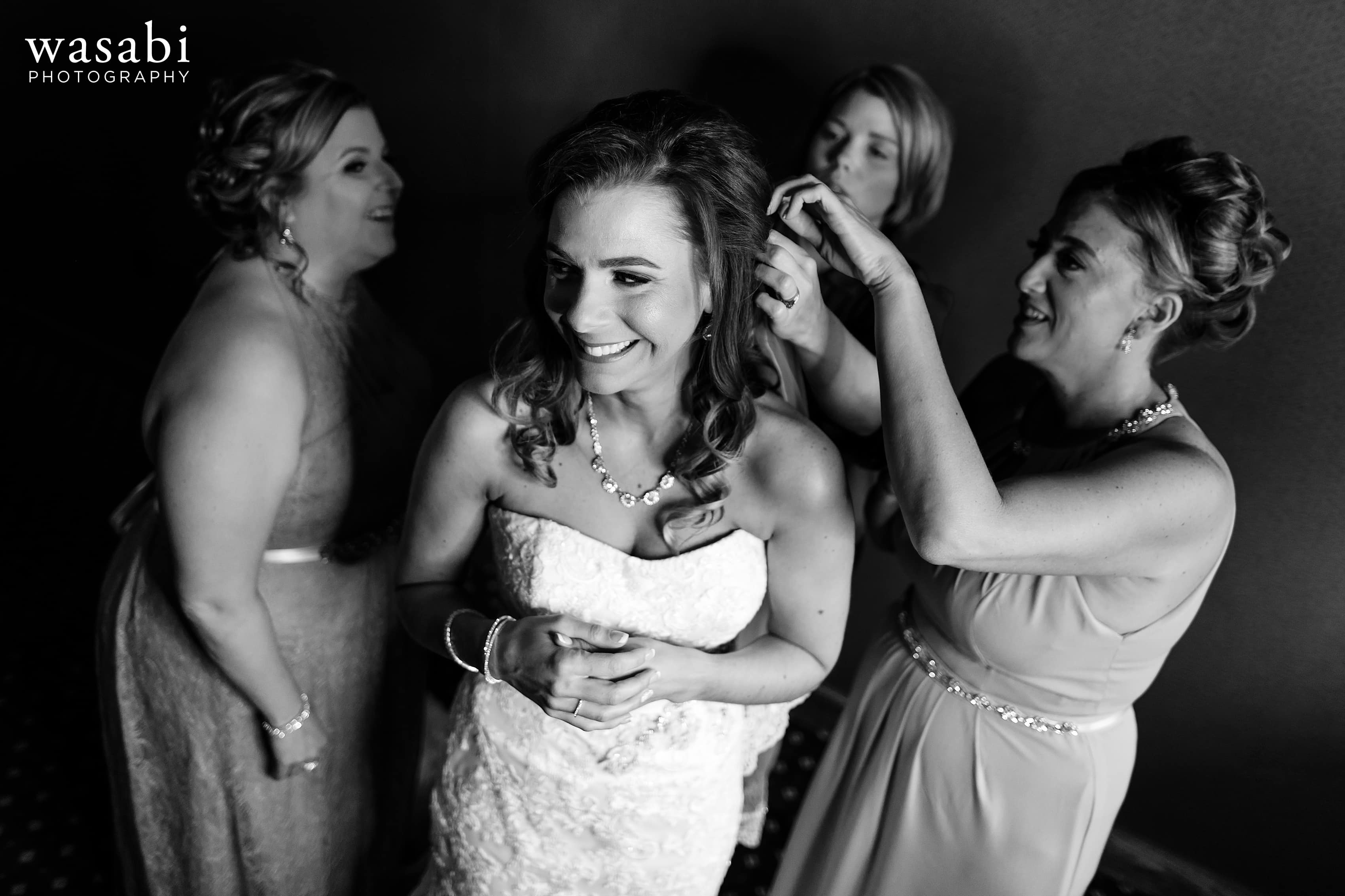 Bride and bridesmaids get ready for wedding at Buck's Run Golf Club in Mount Pleasant, Michigan.