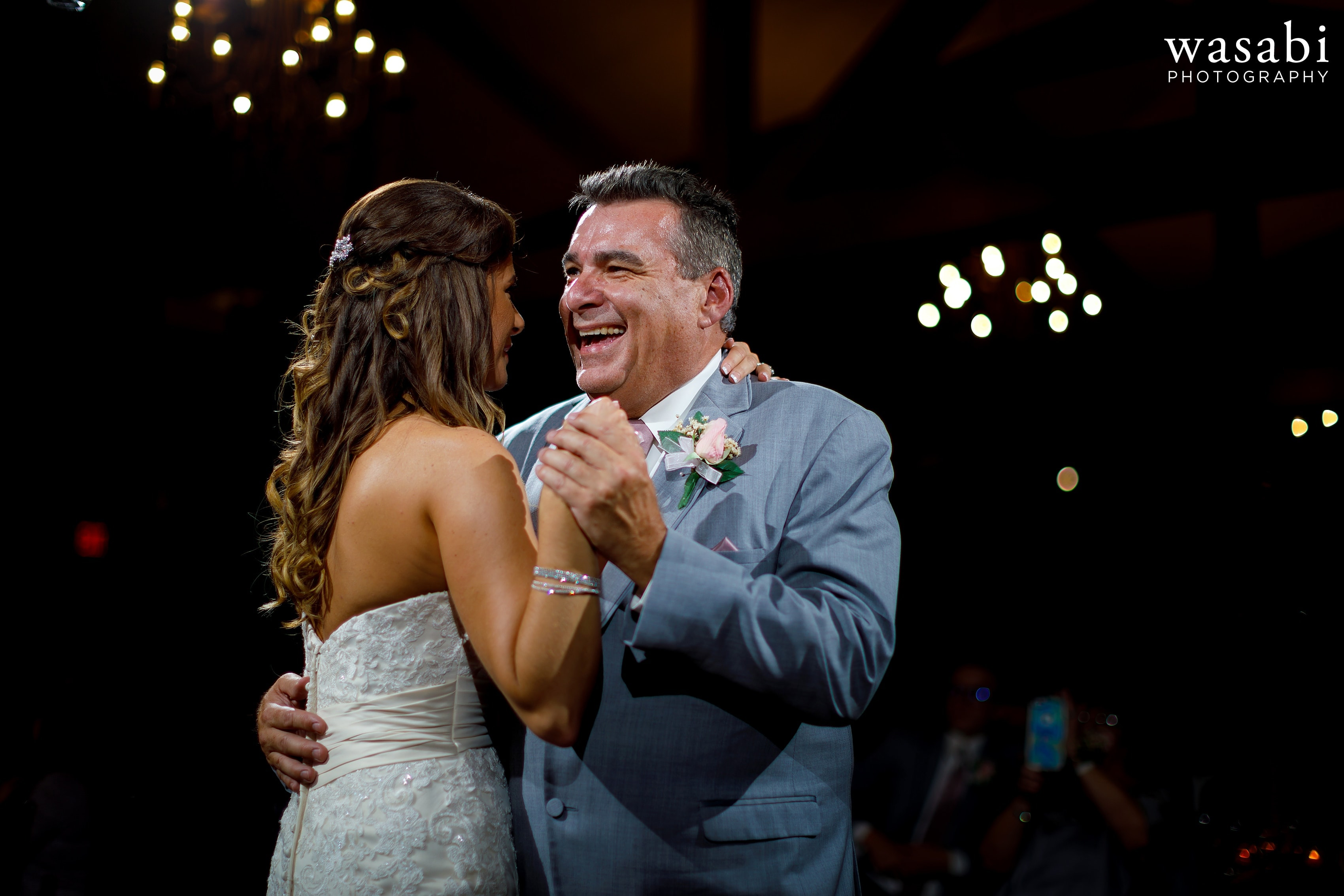 Bride and father of the bride share first dance during Buck's Run Golf Club wedding reception in Mount Pleasant, Michigan.