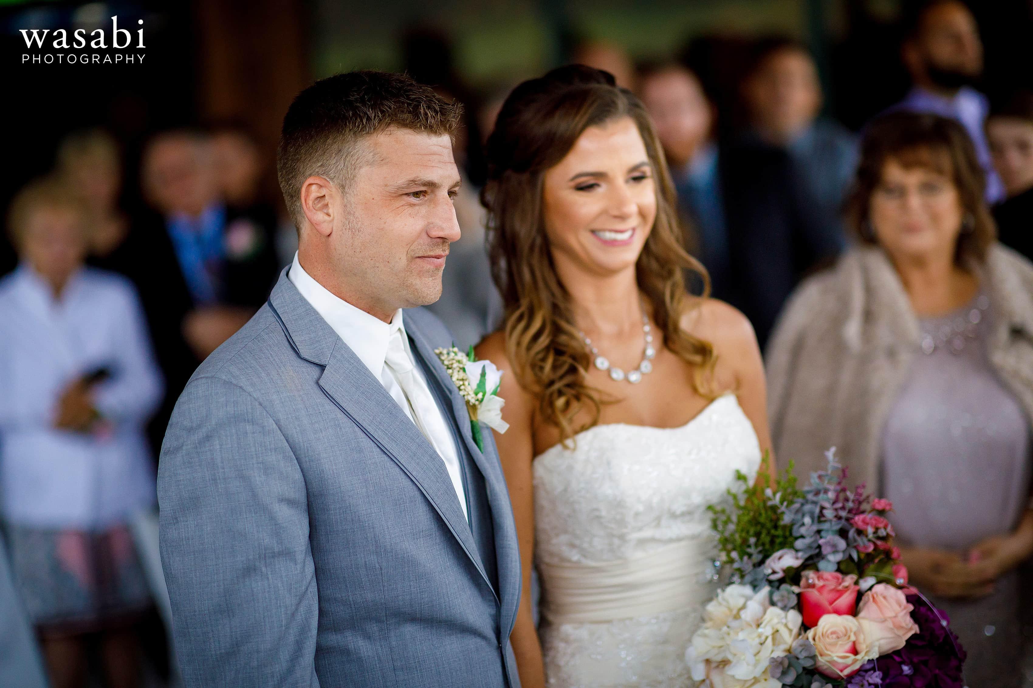 Bride and groom during Buck's Run Golf Club wedding ceremony in Mount Pleasant, Michigan.