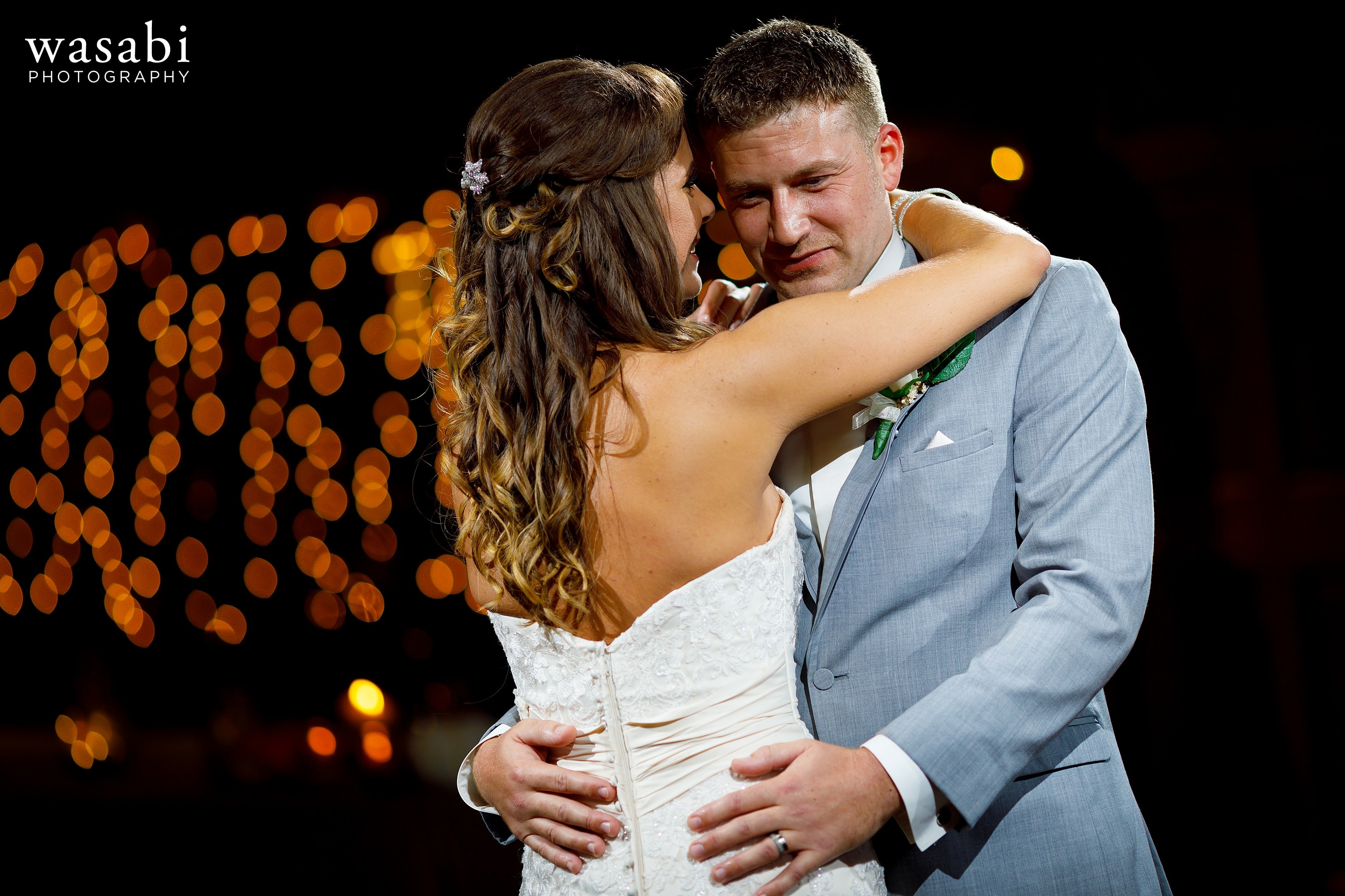 Bride and groom share first dance during Buck's Run Golf Club wedding reception in Mount Pleasant, Michigan.
